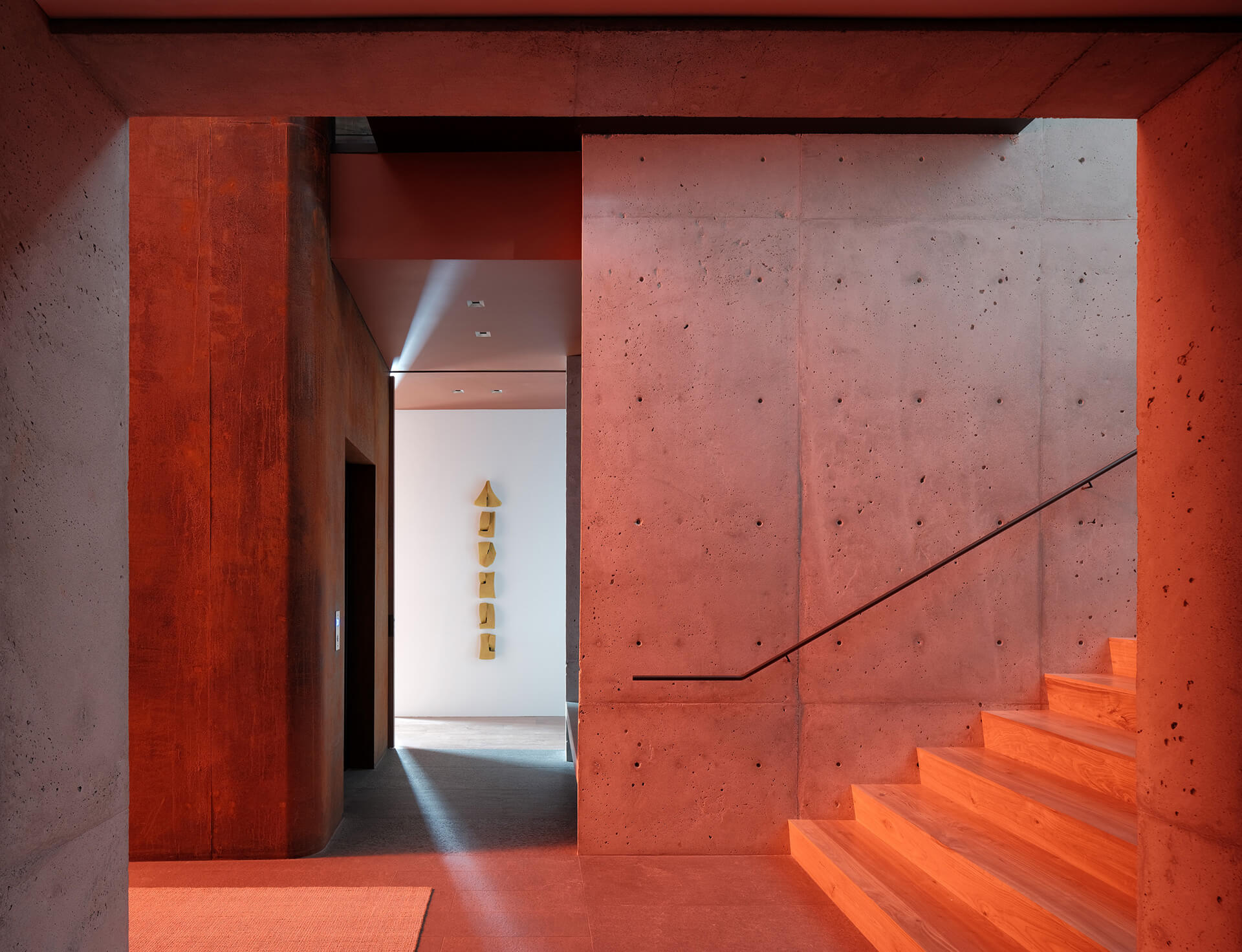 The scarlet glow continues inside | Lookout House by Faulkner Architects | STIRworld