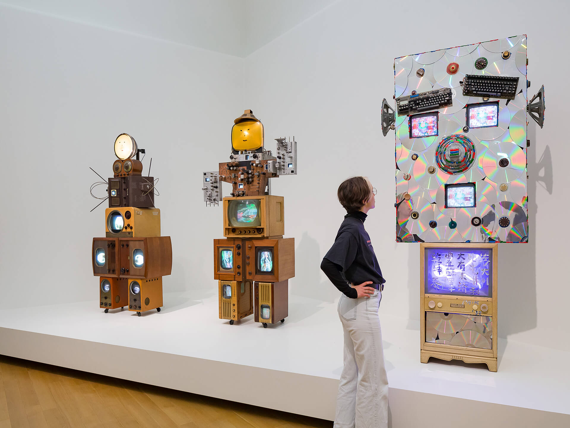 A viewer at The Future Is Now at Stedelijk Museum (2020) | The Future Is Now by Nam June Paik | STIRworld