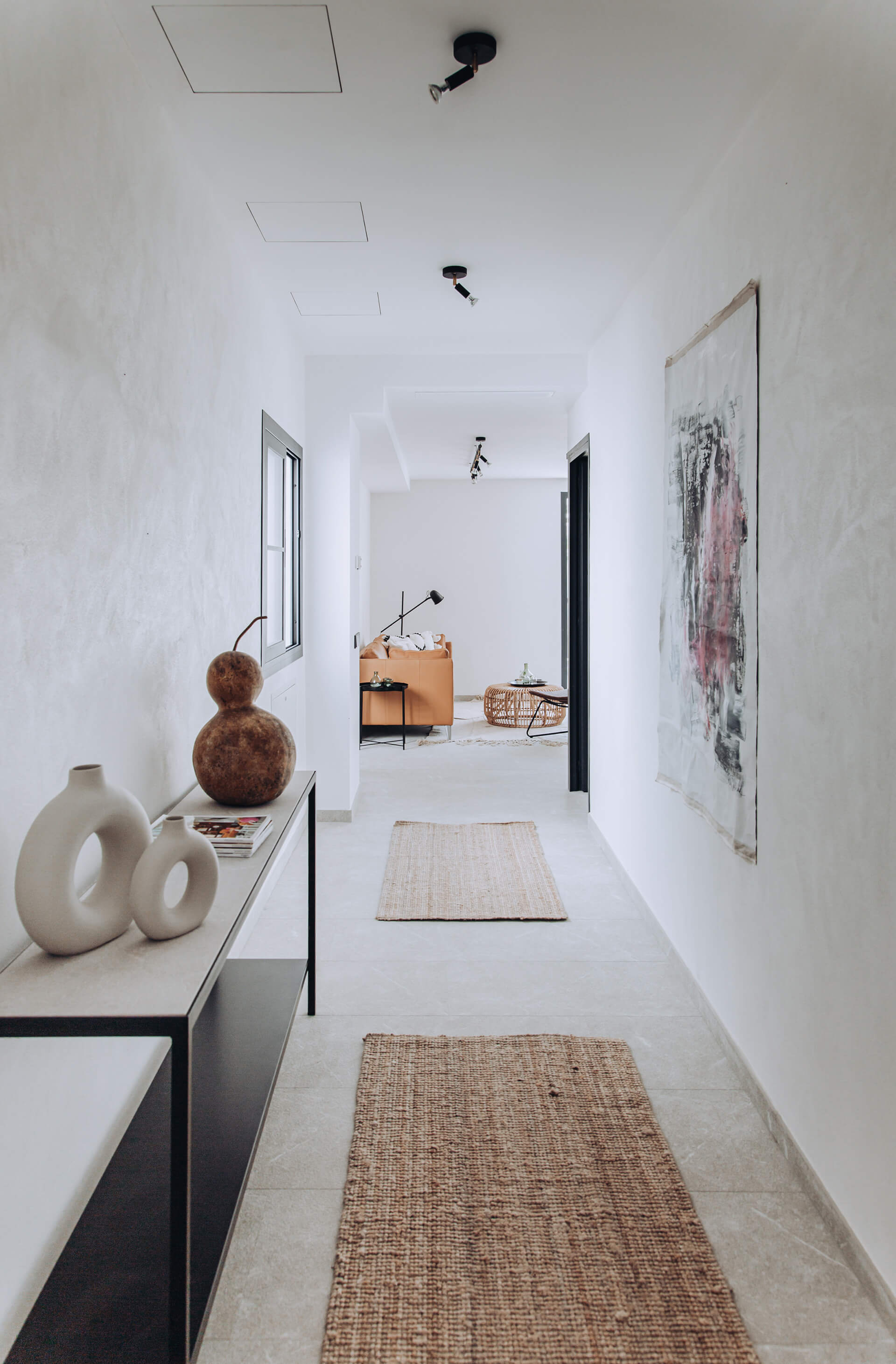 A passage from the entrance leading to the living area| Portixol House by PMA Studio | STIRworld