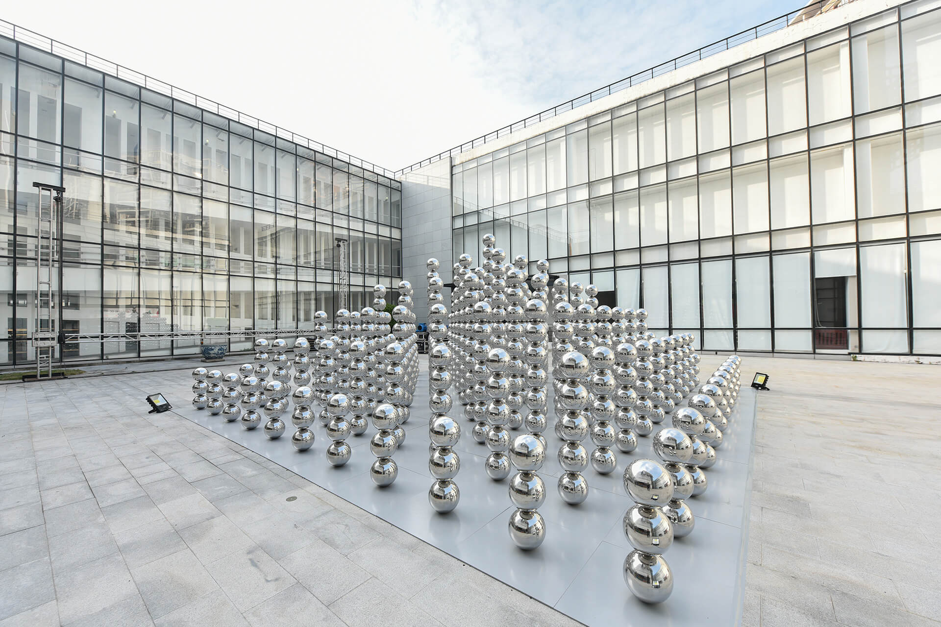 'Half Pyramid' by Lancelin, on display at Wavelength in Shenzhen, uses repetition of the metallic spheres to create a walkthrough installation | Wavelength by Cyril Lancelin | STIRworld