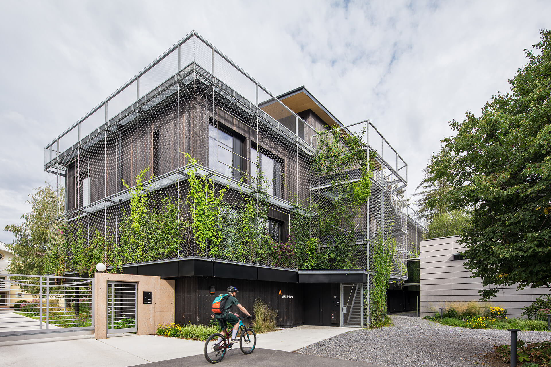 Charred timber façade fitted with metal framing and climbers | ASI Reisen Headquarters by Snøhetta | STIRworld