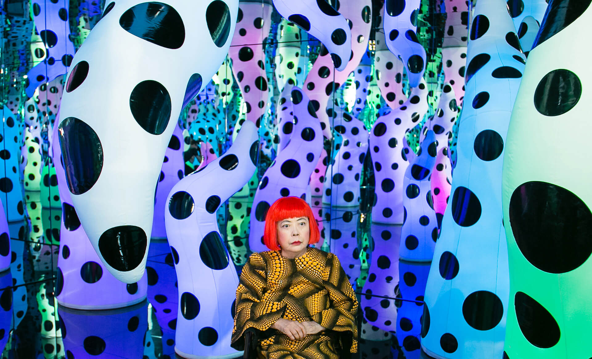 Yayoi Kusama pictured with her work 'LOVE IS CALLING', 2013 during her solo exhibition 'I Who Have Arrived In Heaven' at David Zwirner, New York Courtesy of David Zwirner, New York; Ota Fine Arts, Tokyo/Singapore/Shanghai; Victoria Miro, London/Venice | STIRworld
