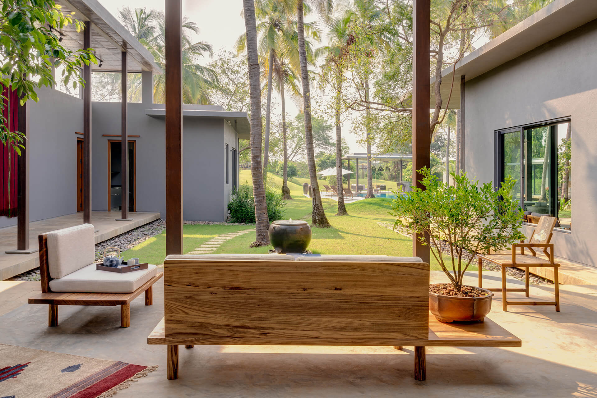 The courtyard with a raised platform that divides the private and public areas | Uminoya – Weekend home in Alibaug | Clay Architecture and Interiors | STIRworld