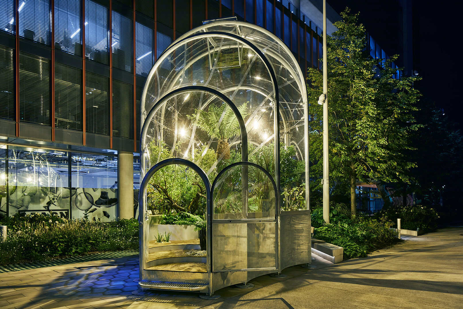 The form of the installation draws inspiration from Victorian glasshouses and England's history of collecting exotic plants from their colonies | The Hothouse, Studio Weave at London Design Festival  | STIRworld