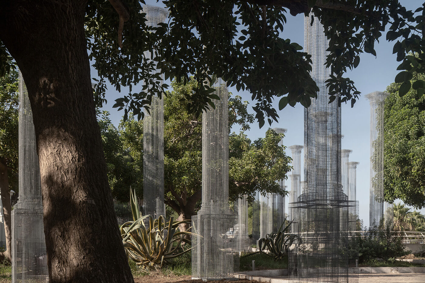 The installation highlights harmonies and contrasts between the pillars and the trees | Opera | Edoardo Tresoldi | STIRworld