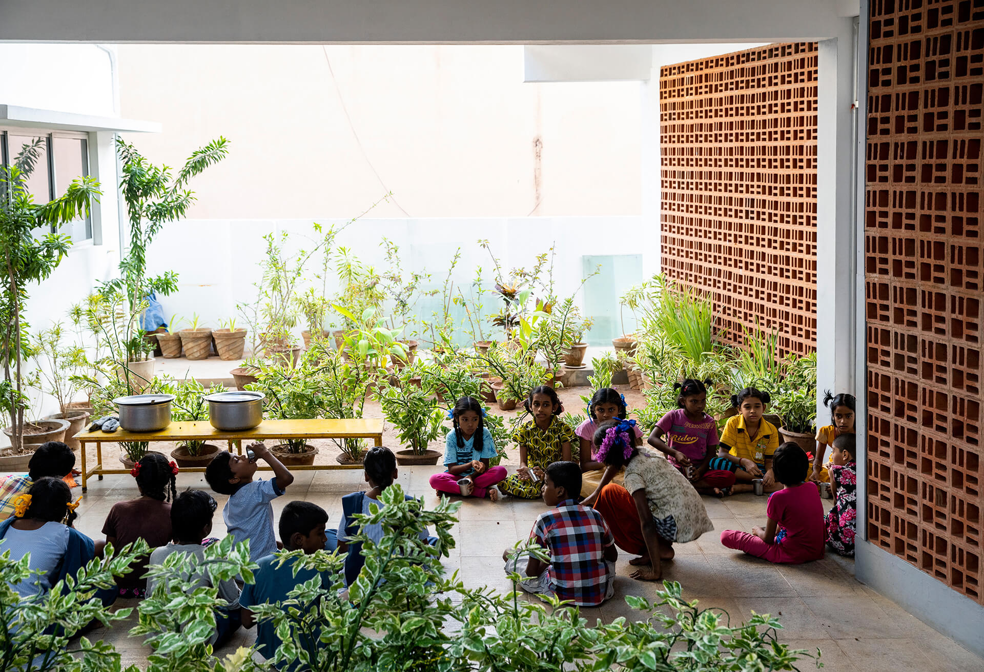 The inner green courtyard which is central to the spaces | Sharana Daycare Facility | Anupama Kundoo Architects | STIRworld
