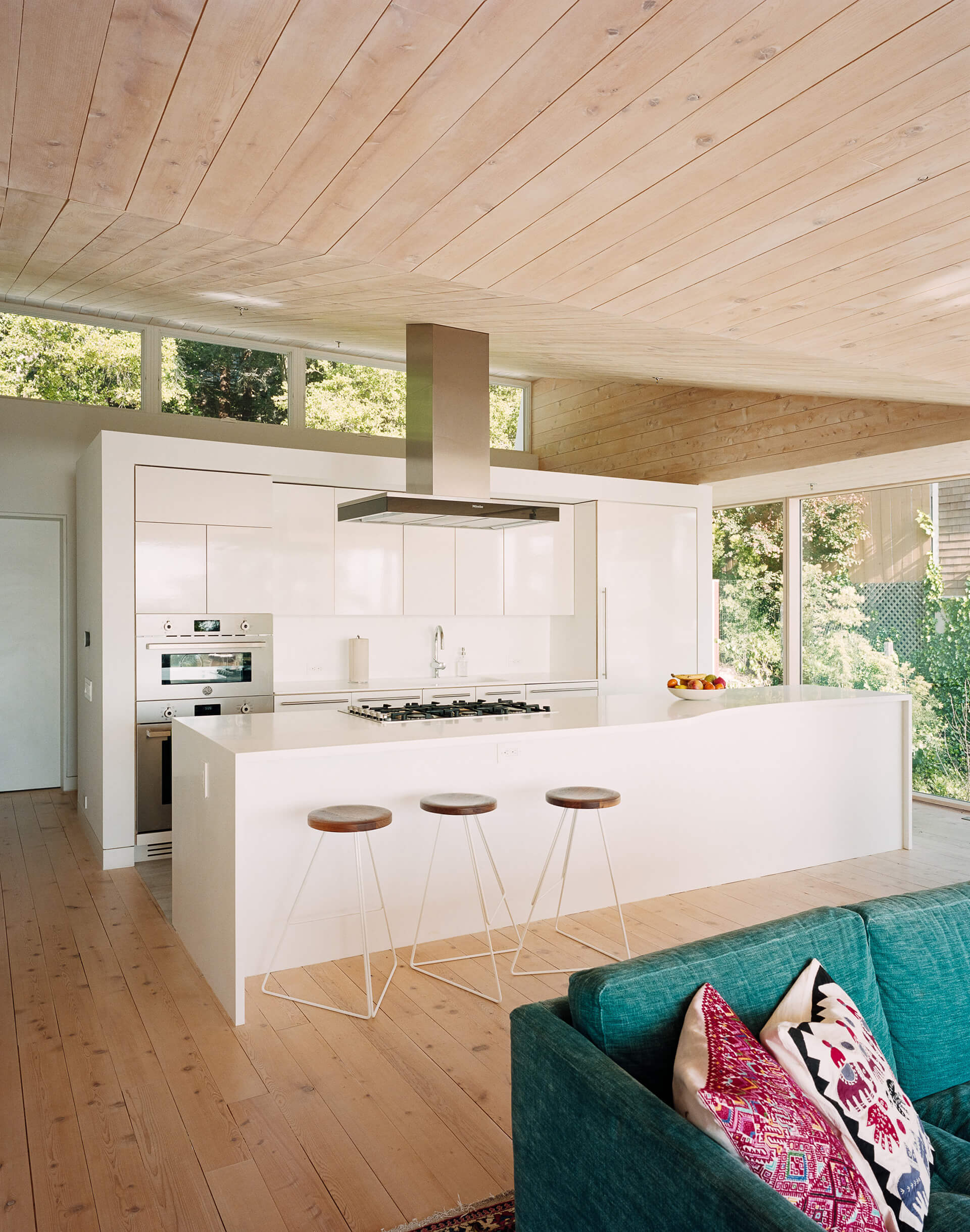 The white kitchen island | House of Light designed by Rangr Studio | STIRworld