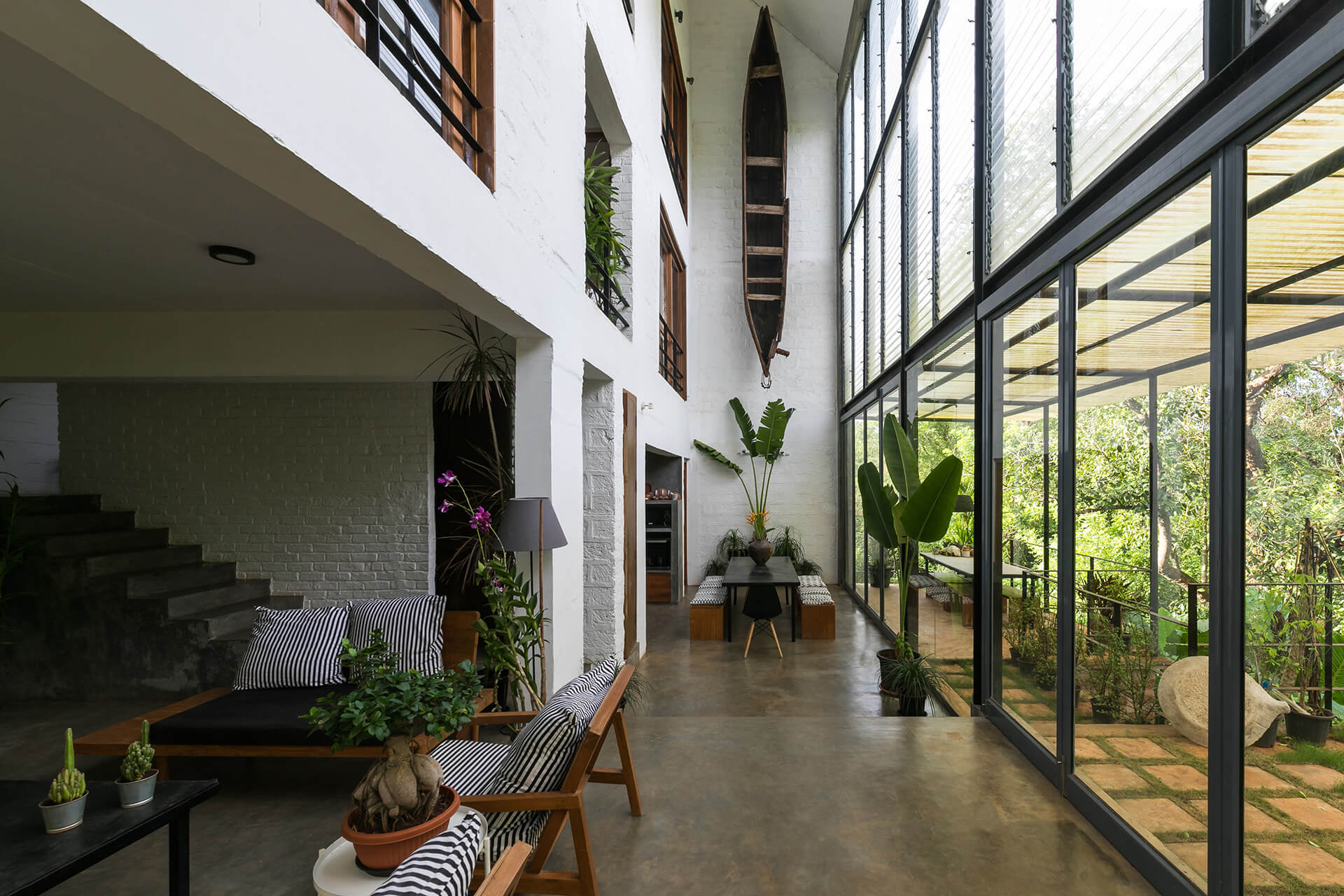 An open-plan on the ground floor accommodates a lounge and dining area| Kokum House | Goa | STIRworld