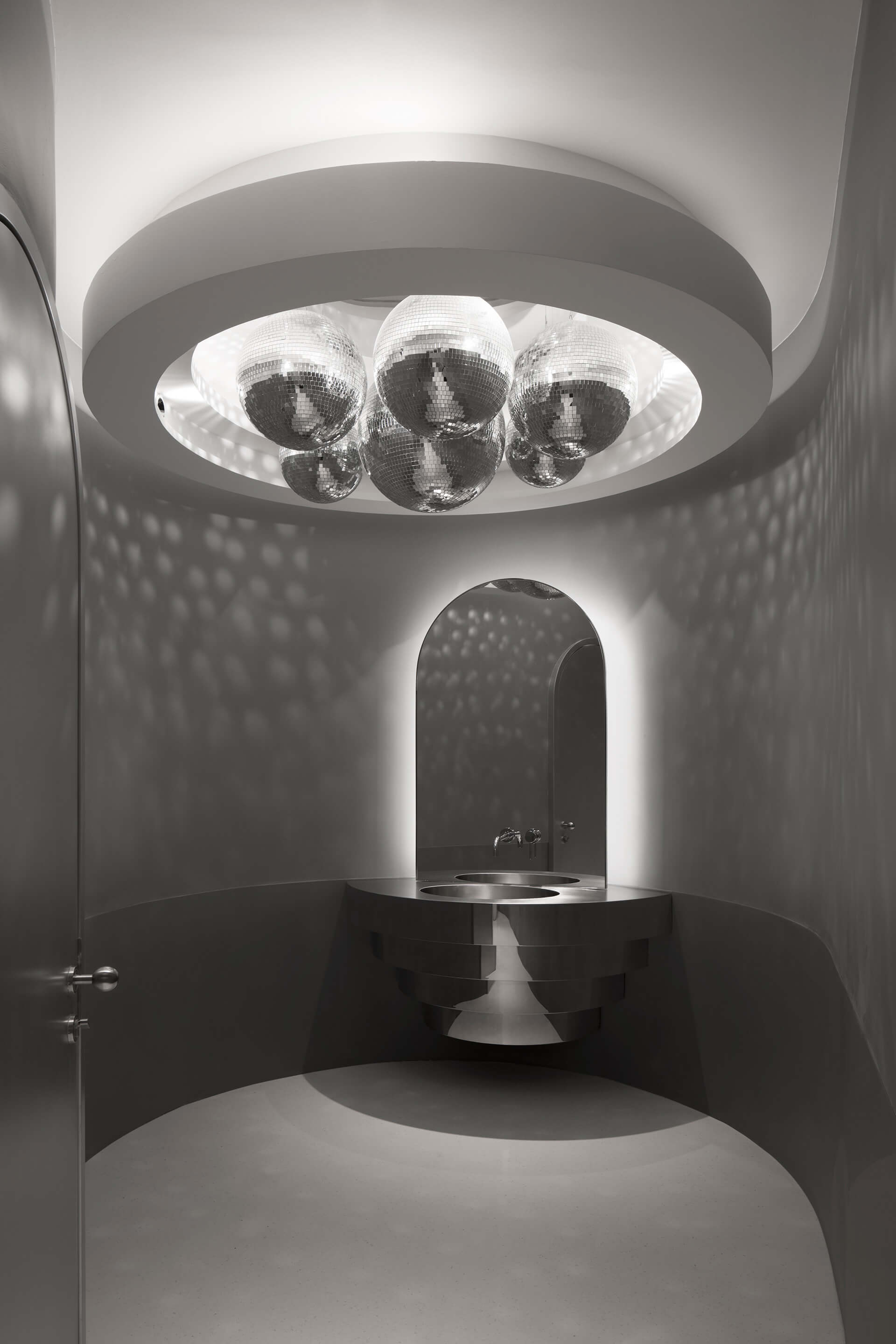 The VIP bathroom is punctuated by an installation of mirror balls | Masquerade by 123 Architects | STIRworld