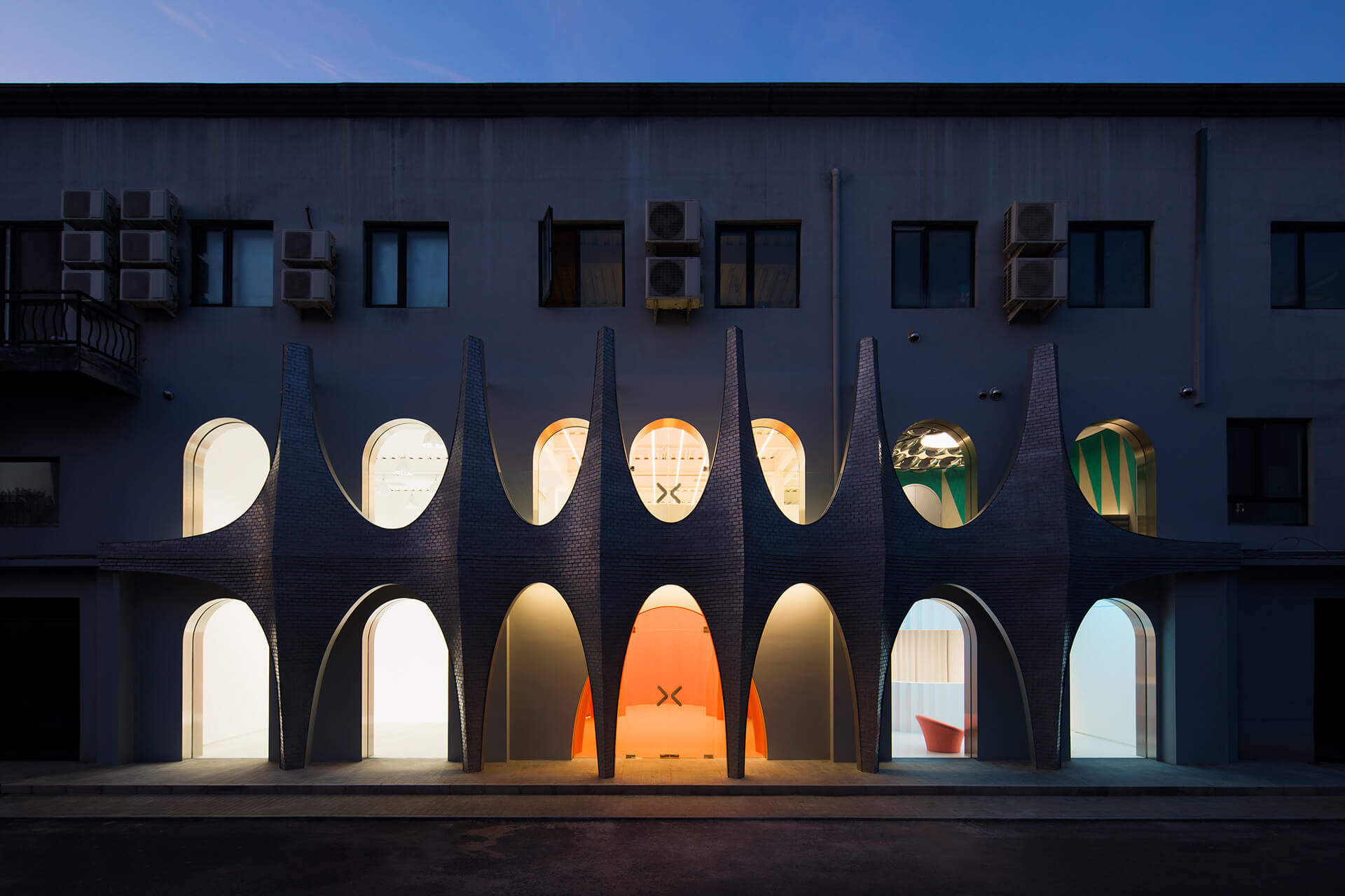 The remodelled facade lures visitors in from the street | Masquerade by 123 Architects | STIRworld