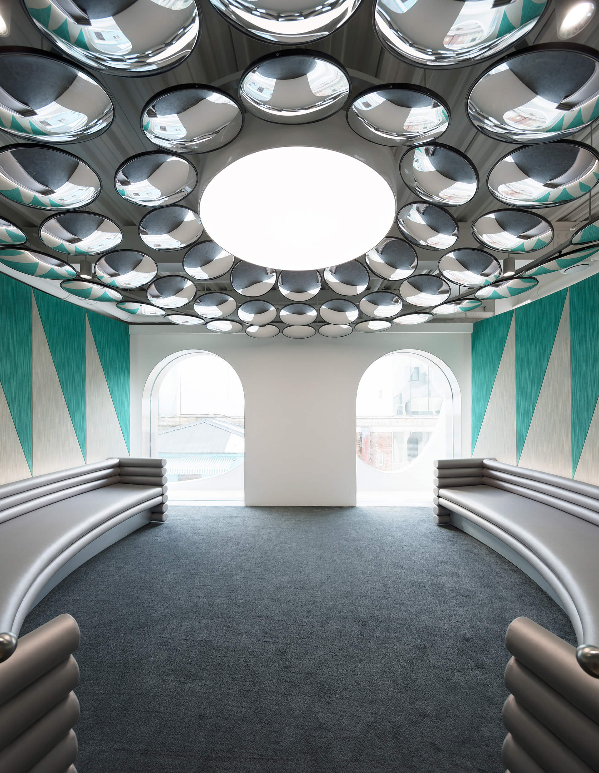 An installation of convex traffic mirrors commands visitors' attention | Masquerade by 123 Architects | STIRworld