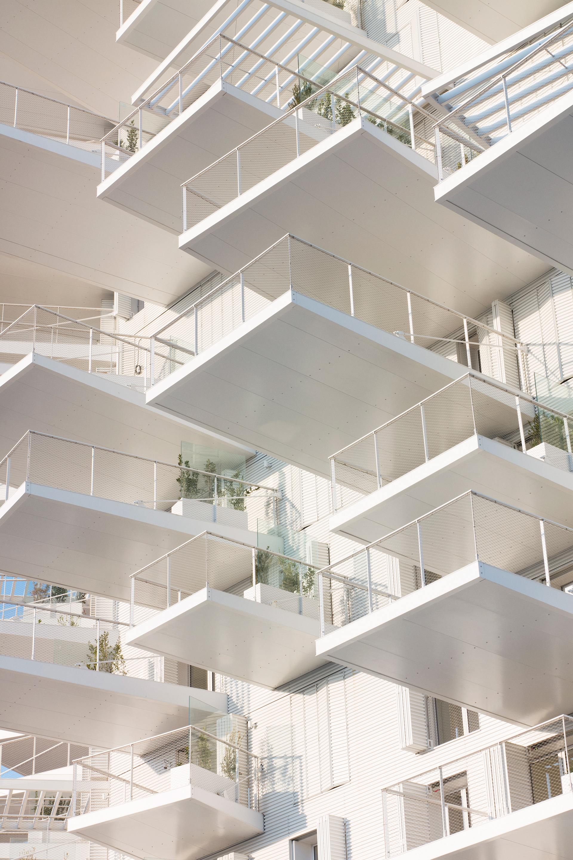 Balconies hanging off the building like the branches of a tree | L'Arbre Blanc| Nicolas Laisné, Manal Rachdi, Sou Fujimoto| STIR