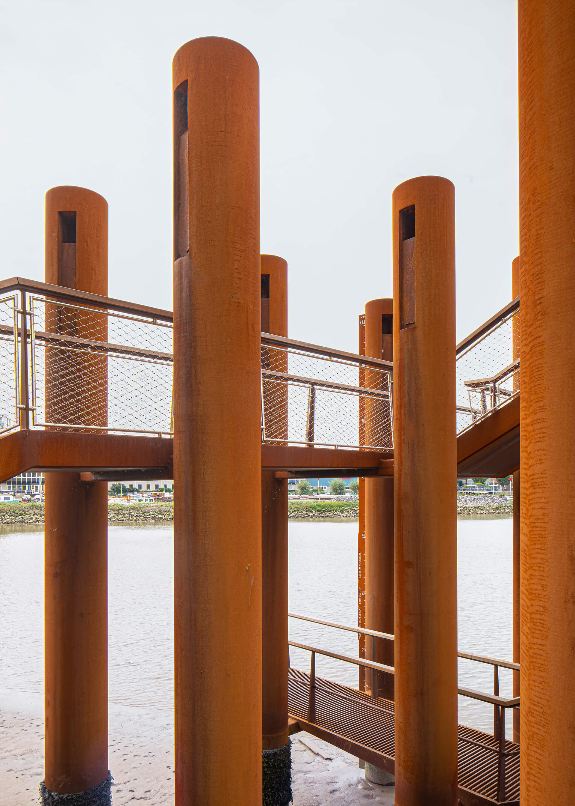 Steel pipes that appear like tree trunks used for the urban landmark | Water Woods Maaspoints | Next Architects | STIRworld