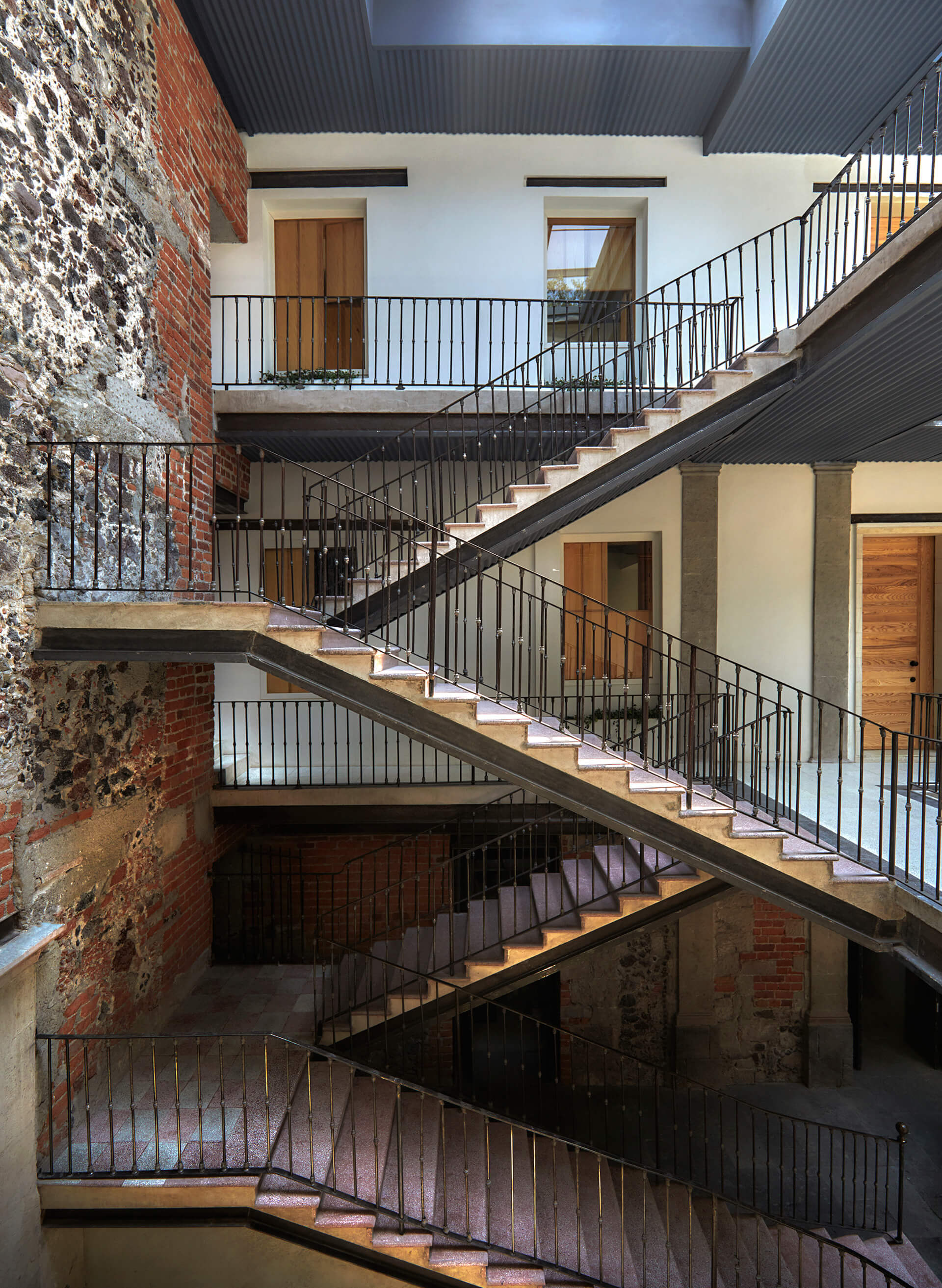 Staircase attached to a crumbling brick wall hints at its rich past | Círculo Mexicano | Ambrosi Etchegaray | STIRworld