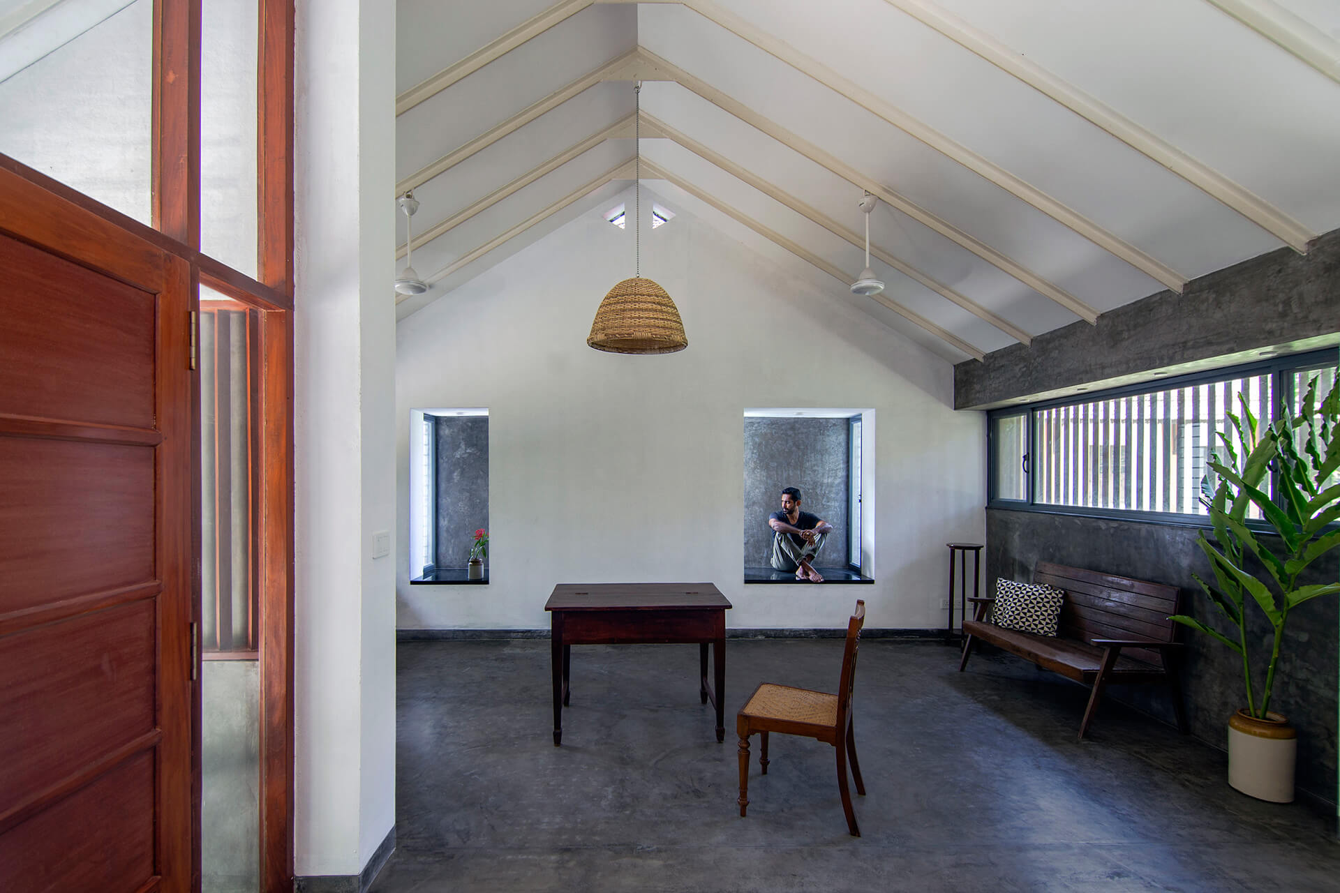 Living area with window sit-outs | Paliam Veedu House | Meister Varma Architects | STIRworld
