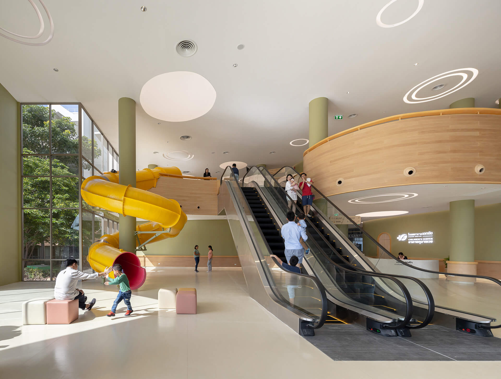A giant yellow slider sits in the entrance hall | EKH Children's Hospital by Integrated Field | STIRworld