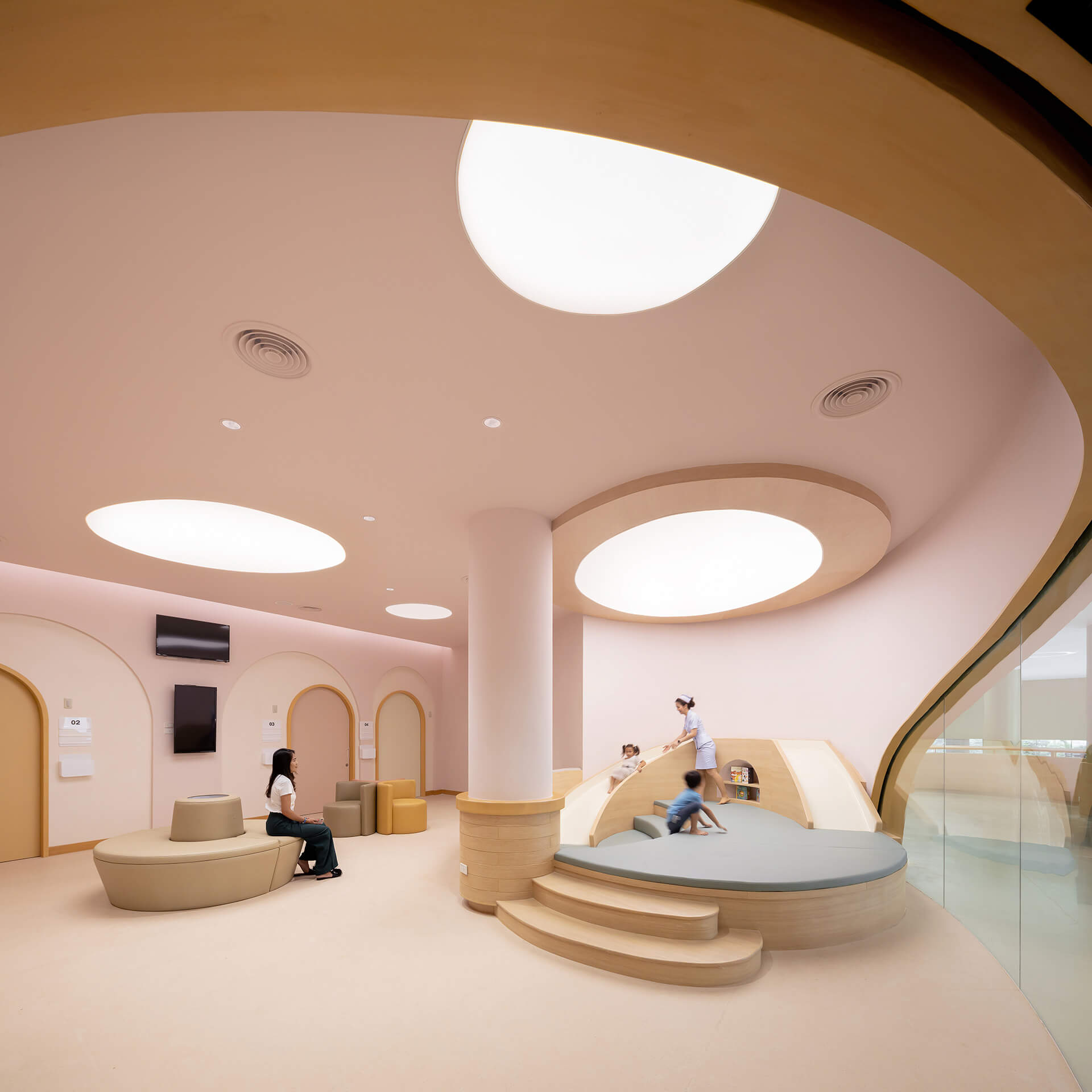 Friendly interiors and rounded furniture | EKH Children's Hospital by Integrated Field | STIRworld