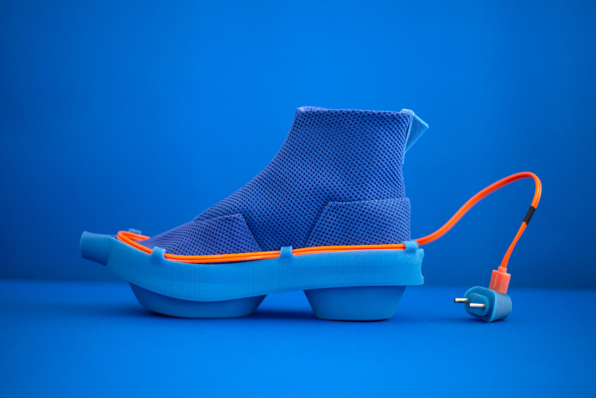 The blue shoes have multiple USB charging ports, wherein people can charge their electronic devices | Netina shoes collection by Netha Goldberg| STIRworld
