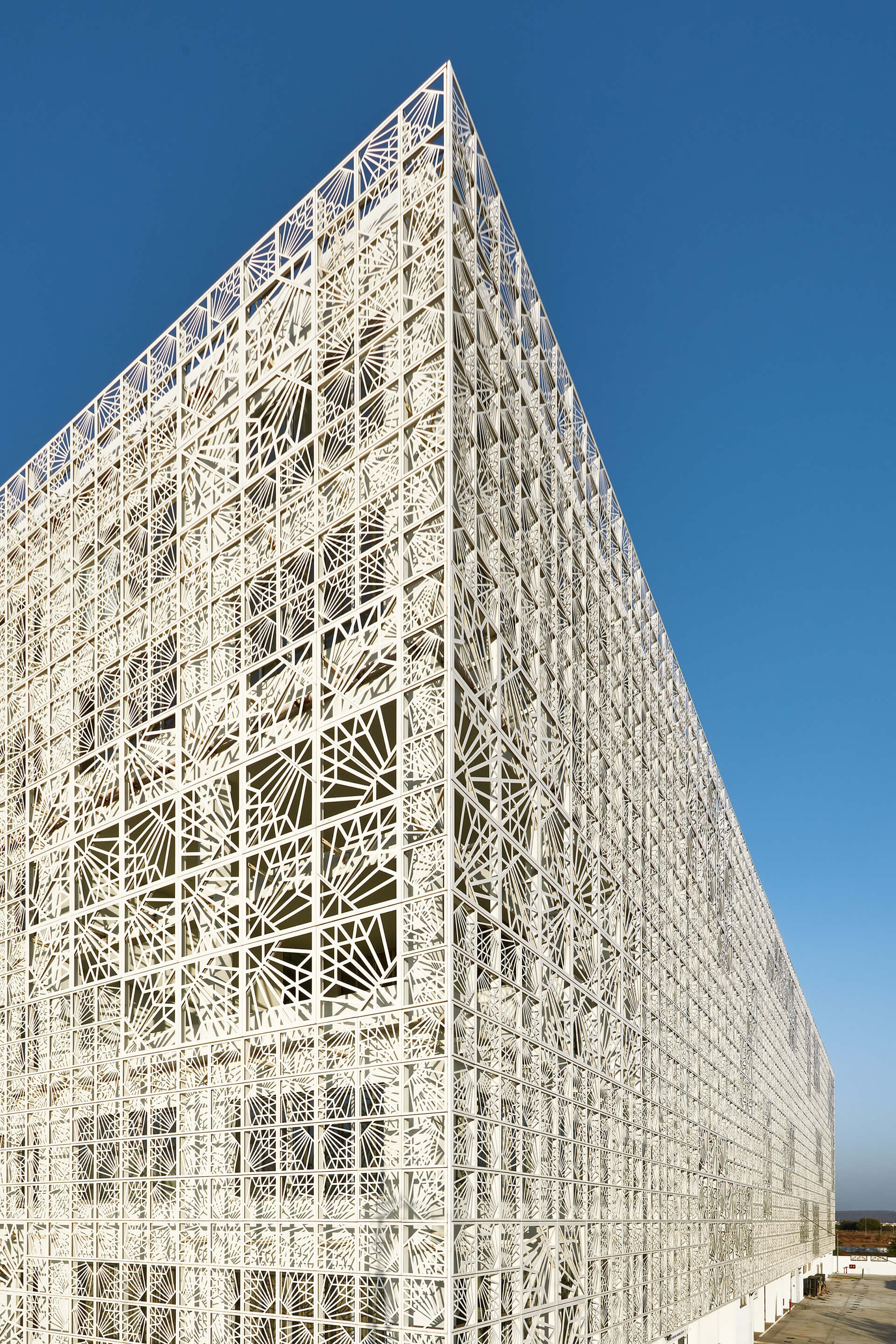 Laser cut latticework patterns decorate the façade | Auric Hall by IMK Architects | STIRworld