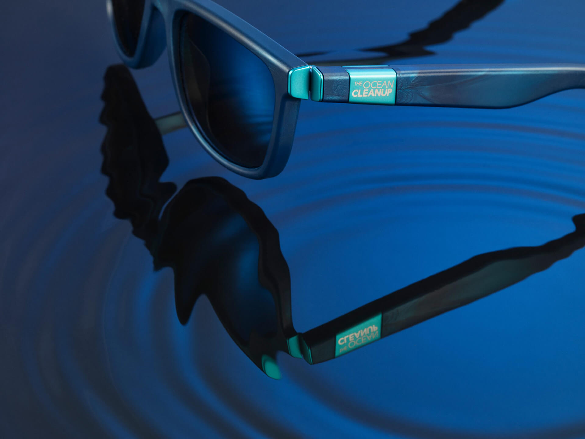 Distinct teal blue hinges | The Ocean Cleanup Sunglasses | STIRworld