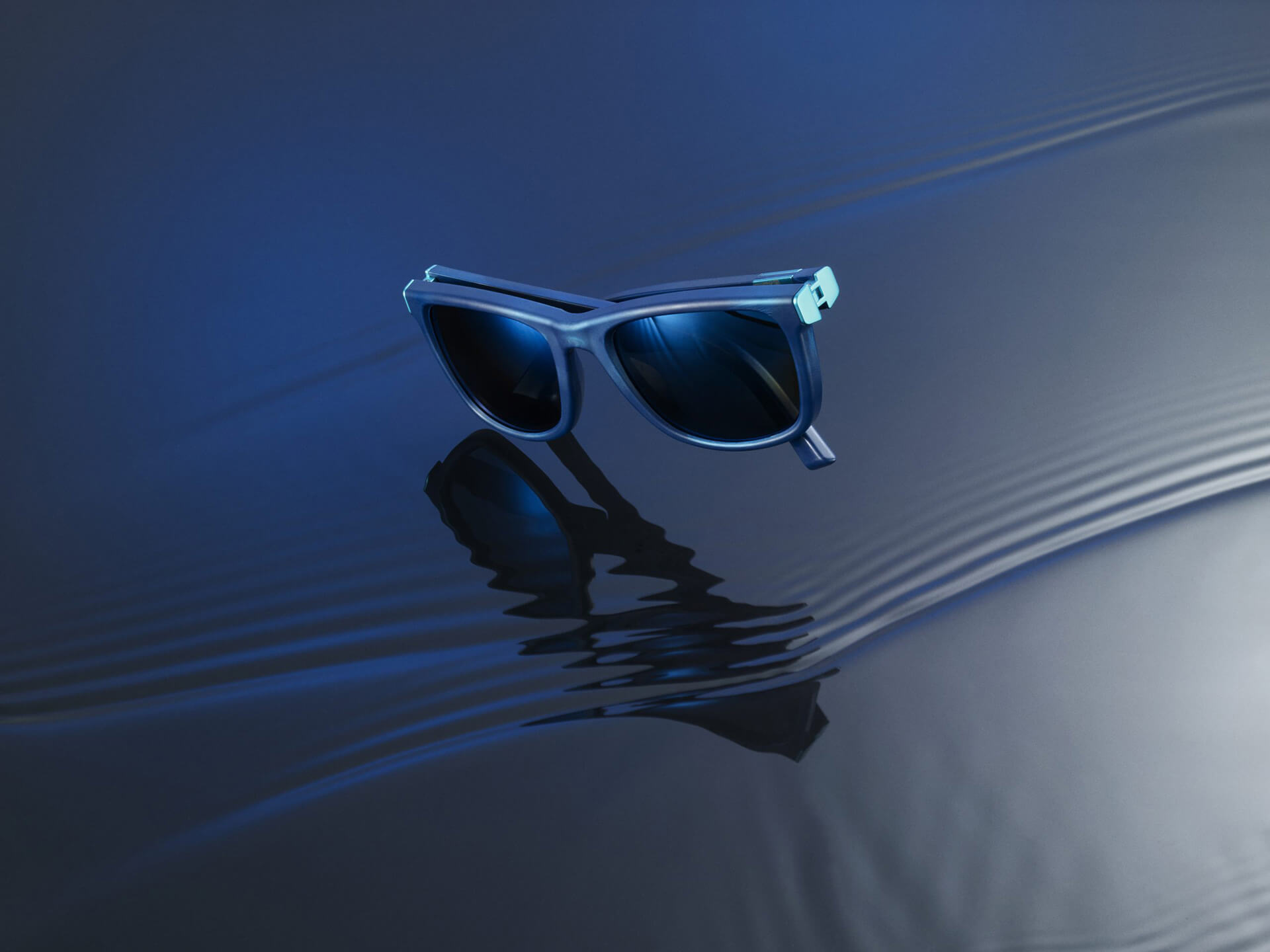 Ink blue shades made from recycled plastic | The Ocean Cleanup Sunglasses | STIRworld