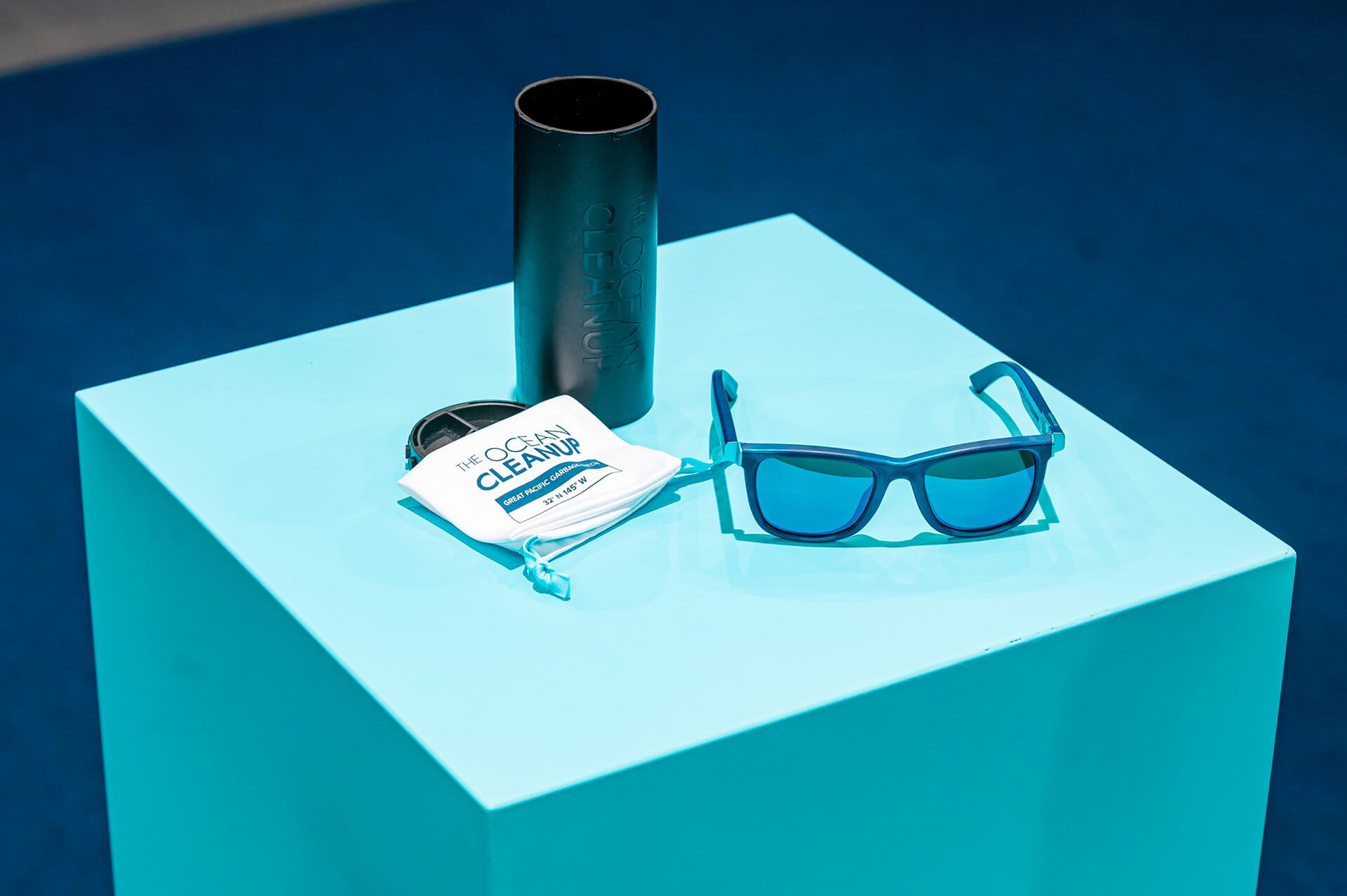 The Ocean Cleanup Sunglasses in their recycled pouch and case | The Ocean Cleanup Sunglasses | STIRworld