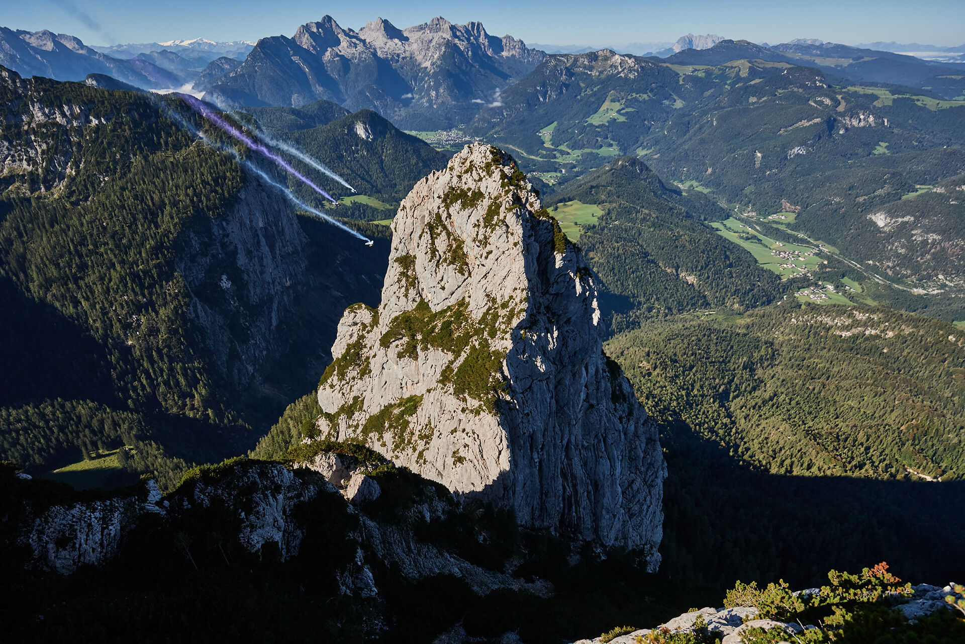 The three pilots including Salzmann wingsuit skydiving in Austria from 3000 metres | Electrified Wingsuit | BMWi, Designworks, Peter Salzmann | STIRworld