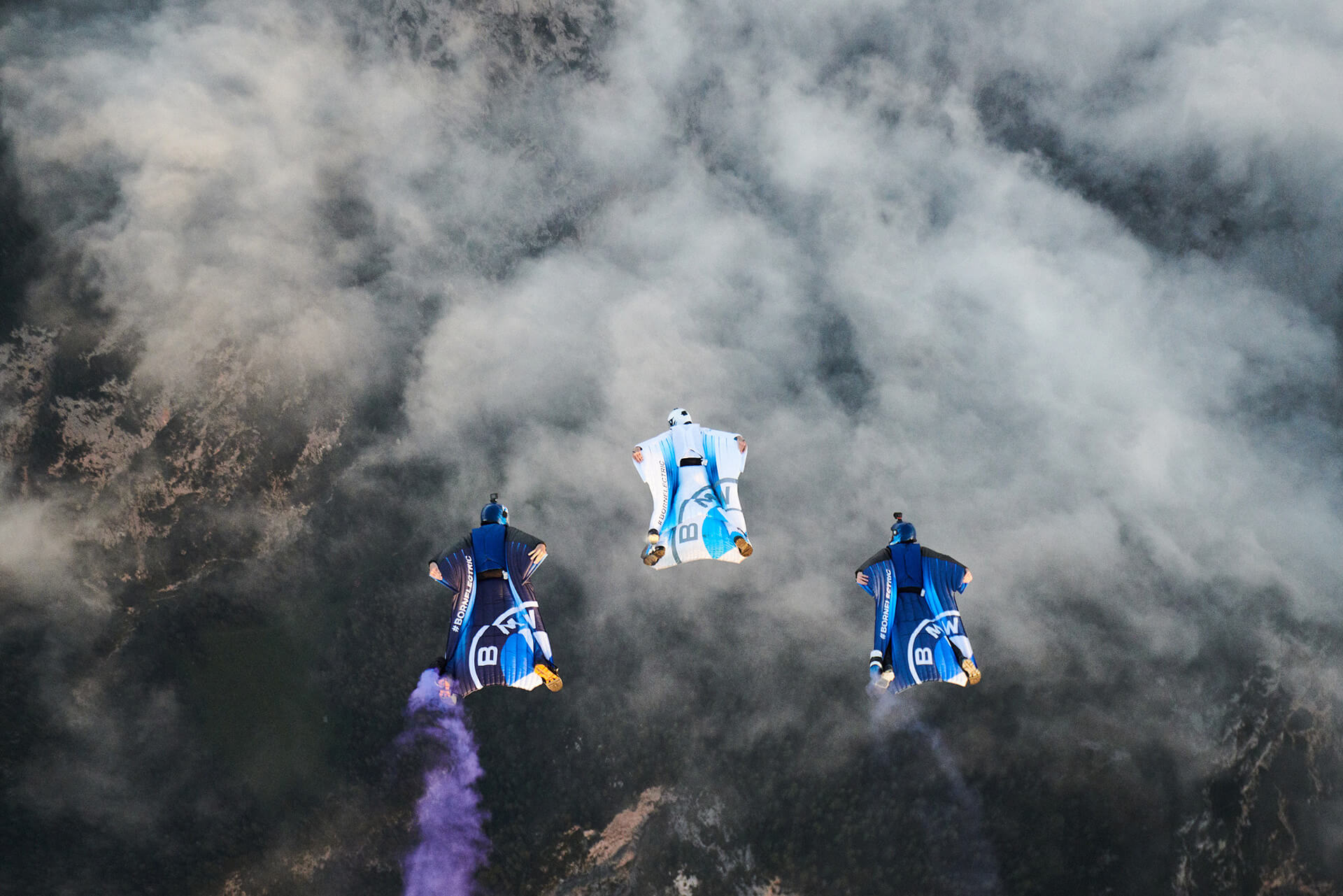 Out of the three pilots, only Salzmann (centre) was wearing the electrified wingsuit | Electrified Wingsuit | BMWi, Designworks, Peter Salzmann | STIRworld