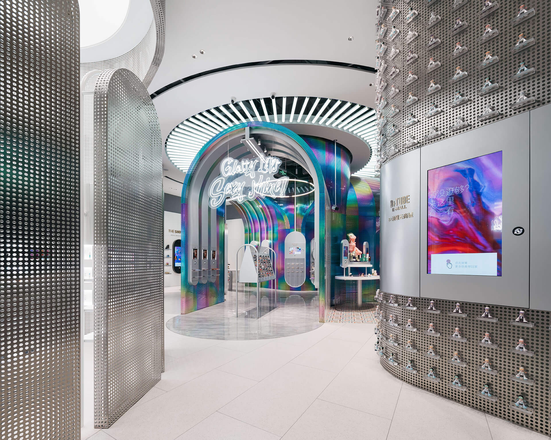 Rainbow-like centre surrounded by steel grey perimeter | B+Tube cosmetics retail store by Storeage | STIRworld