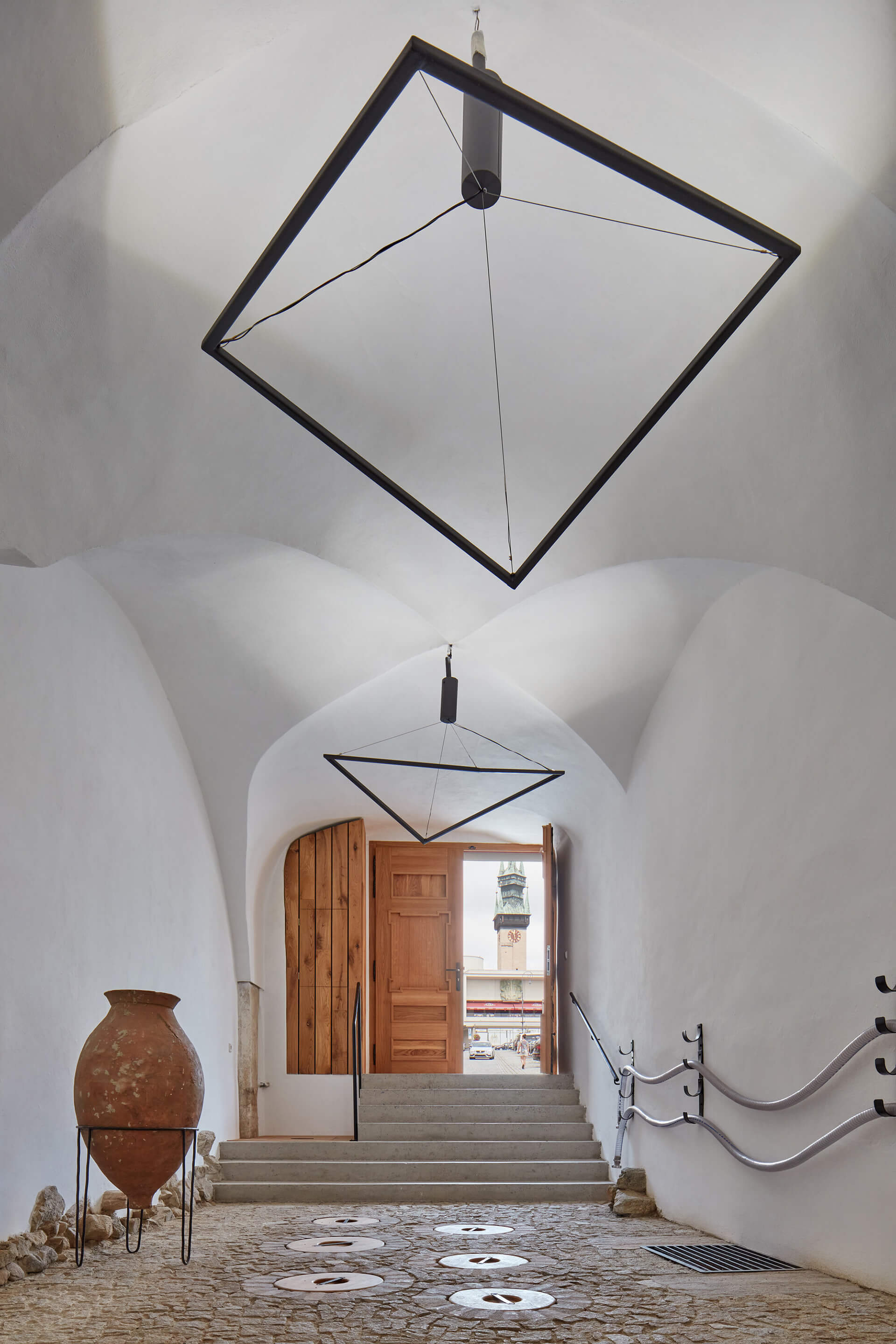 The entrance passage with the floor embedded ceramic wine vessels |Winery Nešetřil by ORA | STIRworld