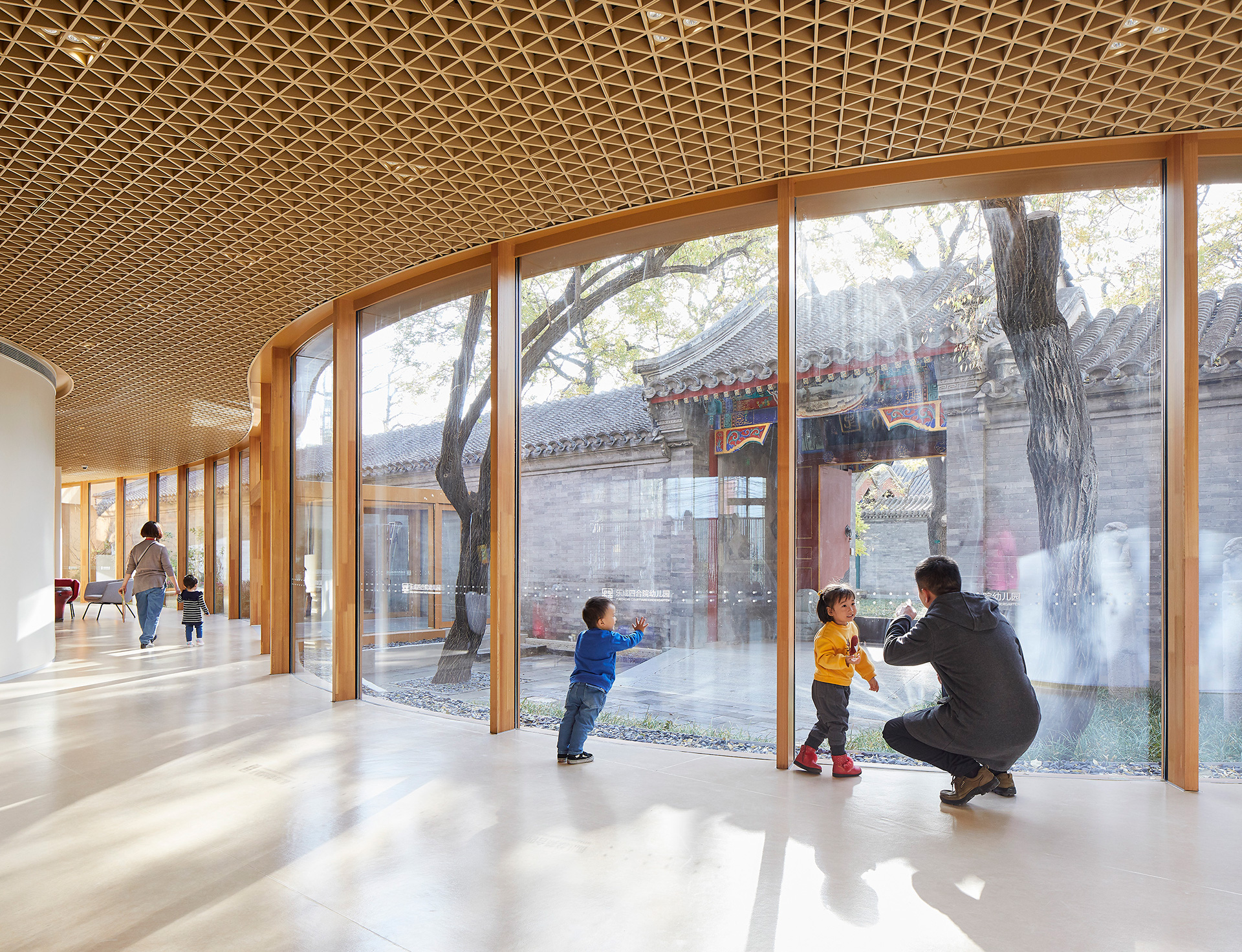 The new internal courtyard made with warm timber and glass walls | YueCheng Courtyard Kindergarten designed by MAD | STIRworld