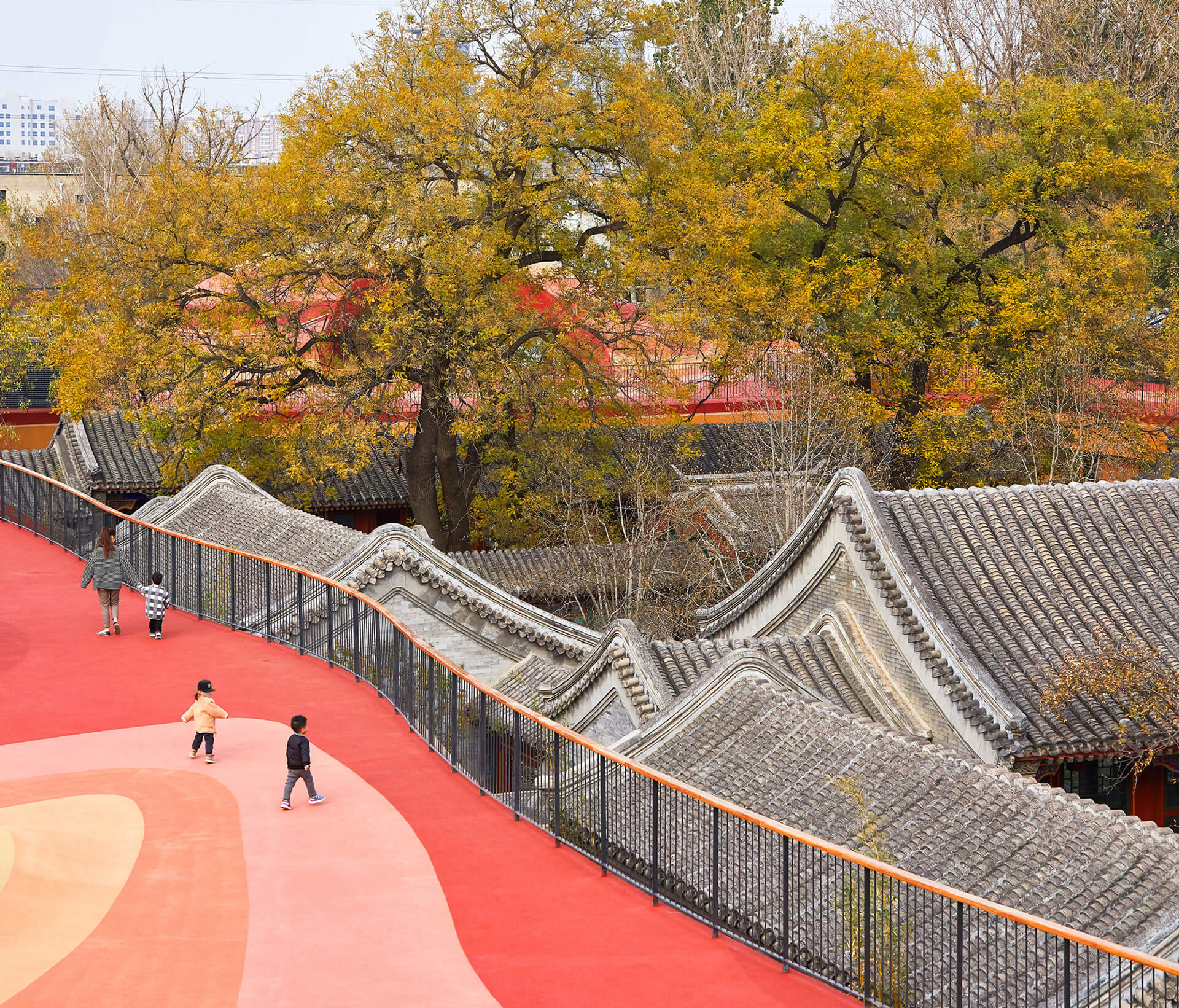 The colourful roof sits in bright contrast to the historic buildings | YueCheng Courtyard Kindergarten designed by MAD | STIRworld