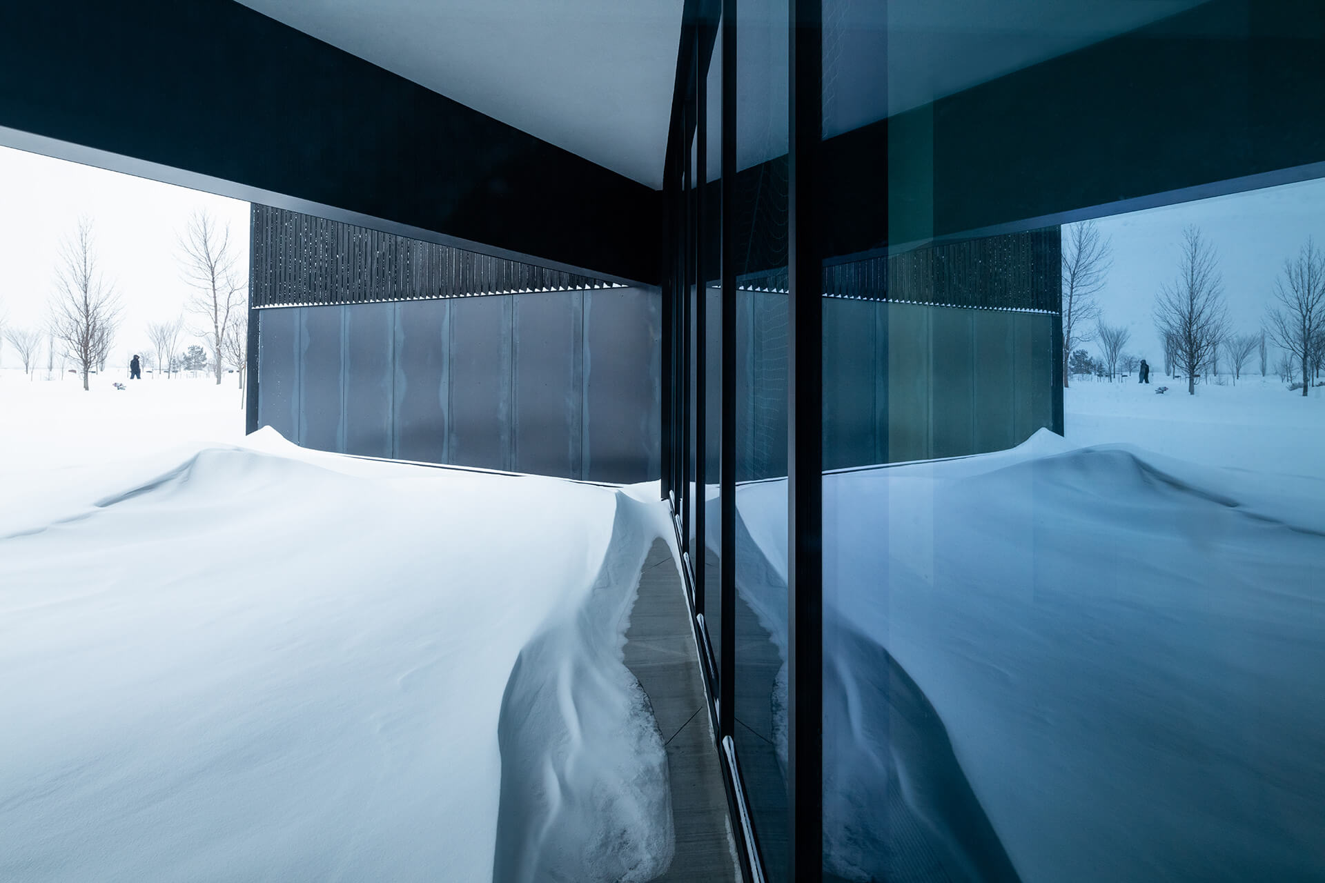 The icy blue glass façade reflects the snow outside | South Haven Centre for Remembrance by Shape Architecture | STIRworld