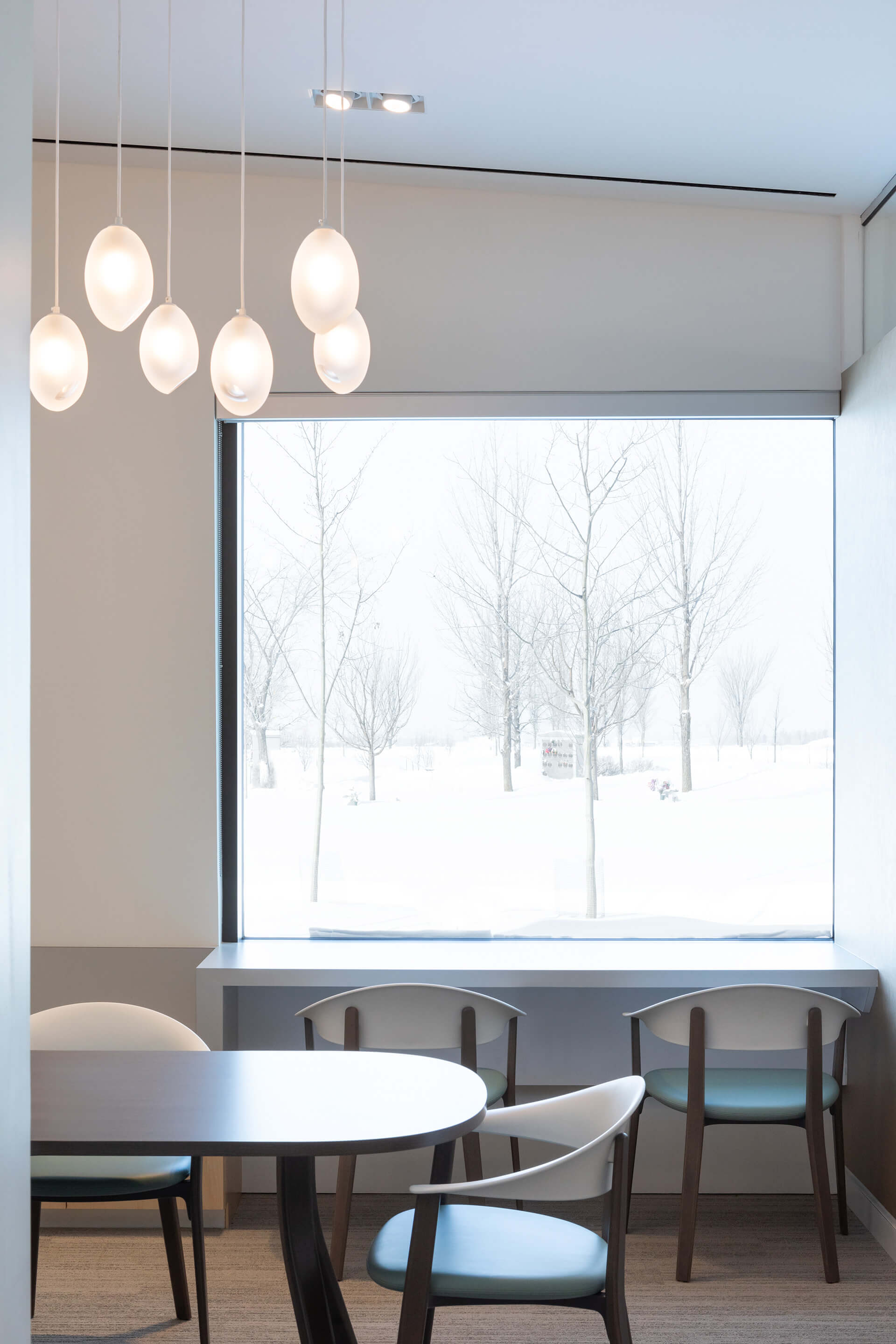 The 'Spirit Light' fixture hangs inside the warm interior spaces | South Haven Centre for Remembrance by Shape Architecture | STIRworld