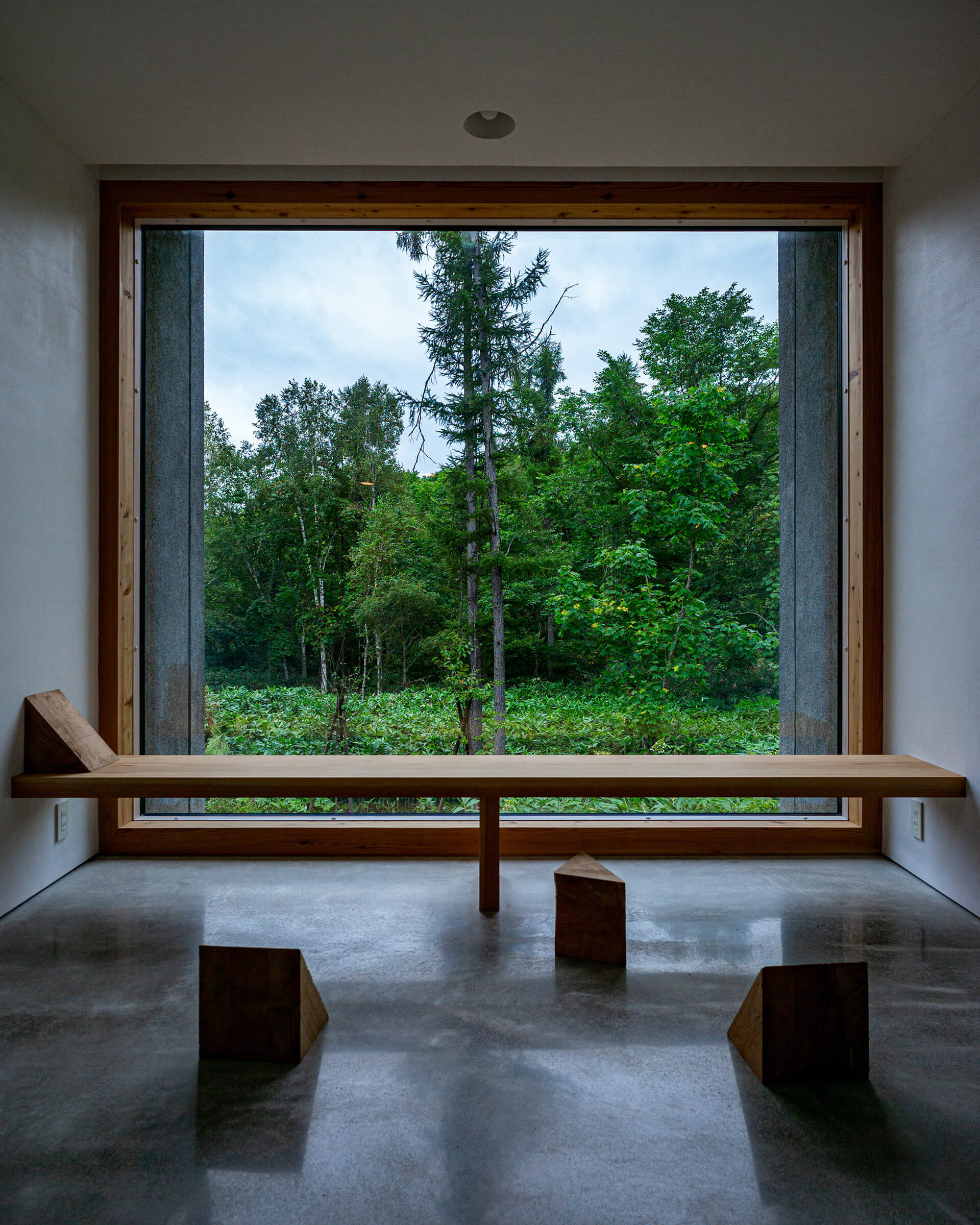 The volumes' ends feature large glass windows | House in the Forest designed by Florian Busch Architects | STIRworld
