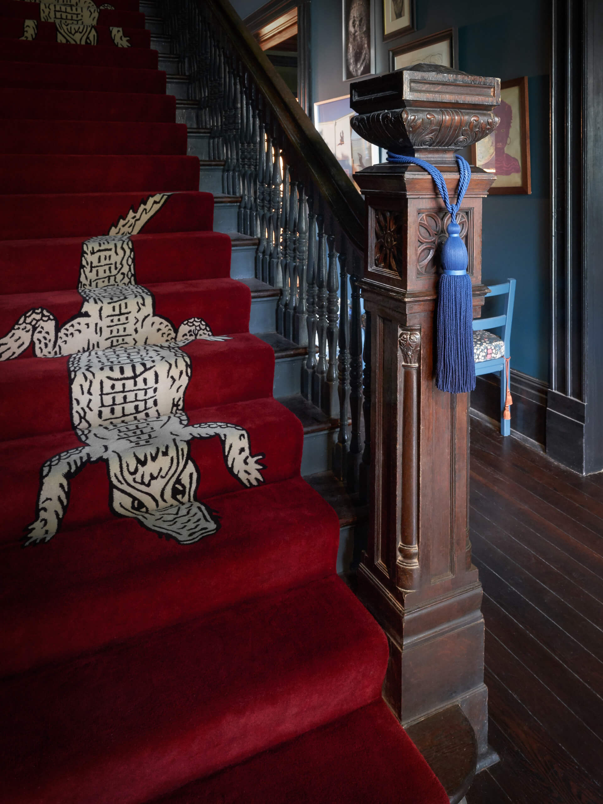 Alligator carpet on the main staircase | The Chloe designed by Sara Costello | STIRworld