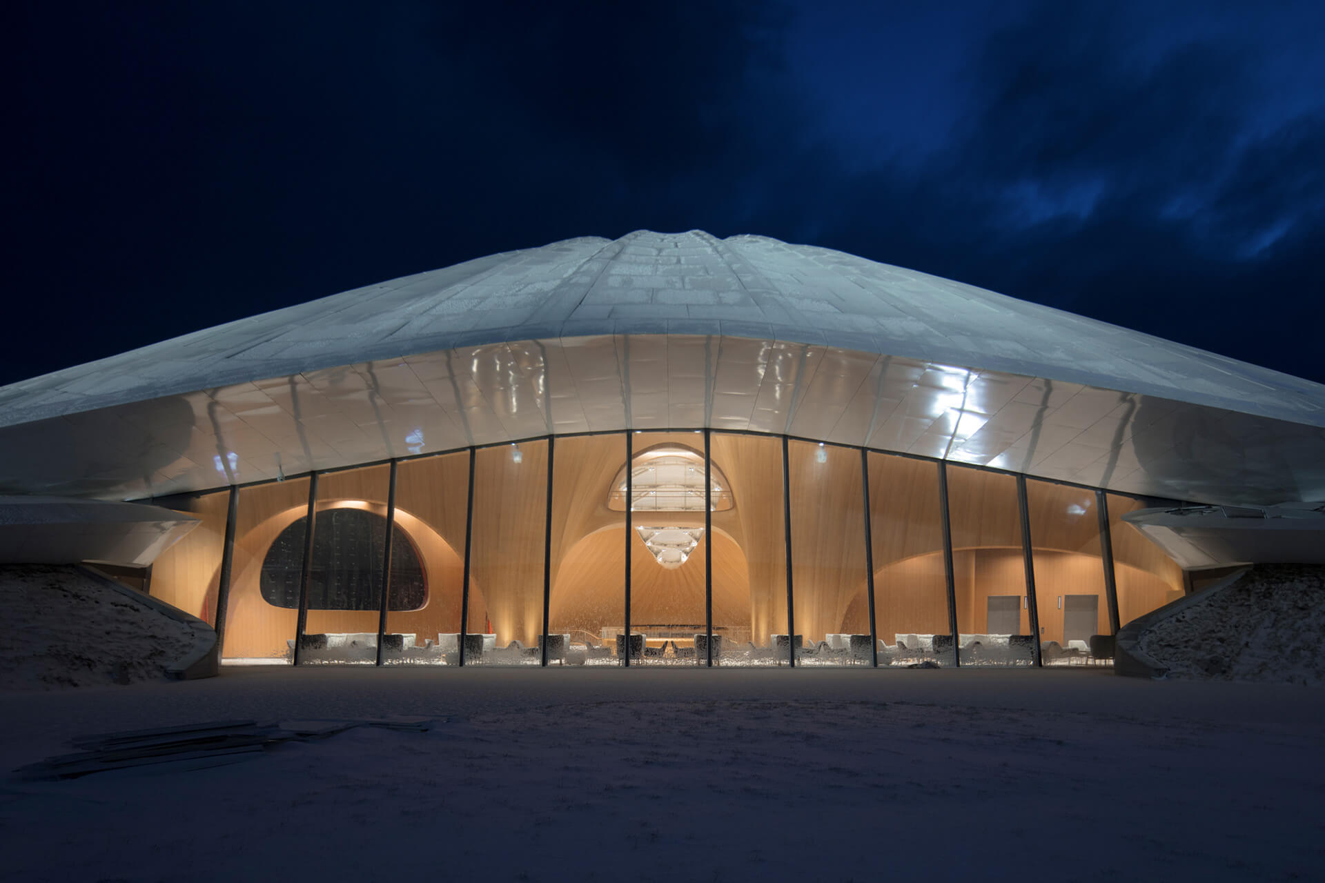 The white roof sits atop a glass exterior | Yabuli Entrepreneurs' Congress Center designed by MAD Architects | STIRworld