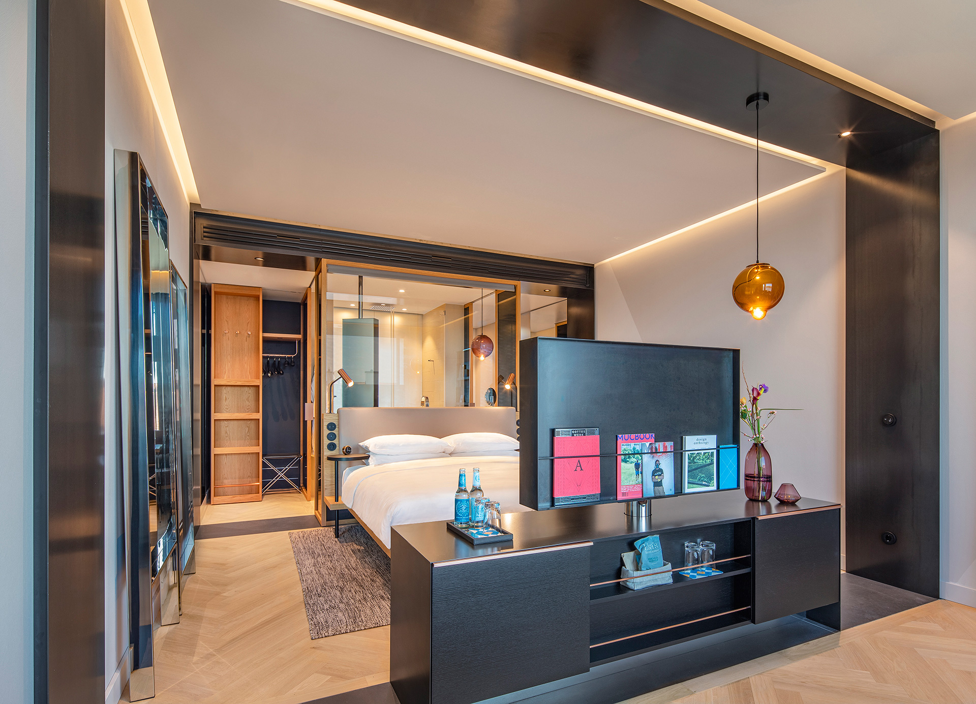 A modern loft was the inspiration for hotel rooms where instead of conventional walls, two raw steel frames divide it into a bathroom, bedroom and living area to create a contemporary en-suite| Andaz Munich Schwabinger Tor| Concrete| STIR
