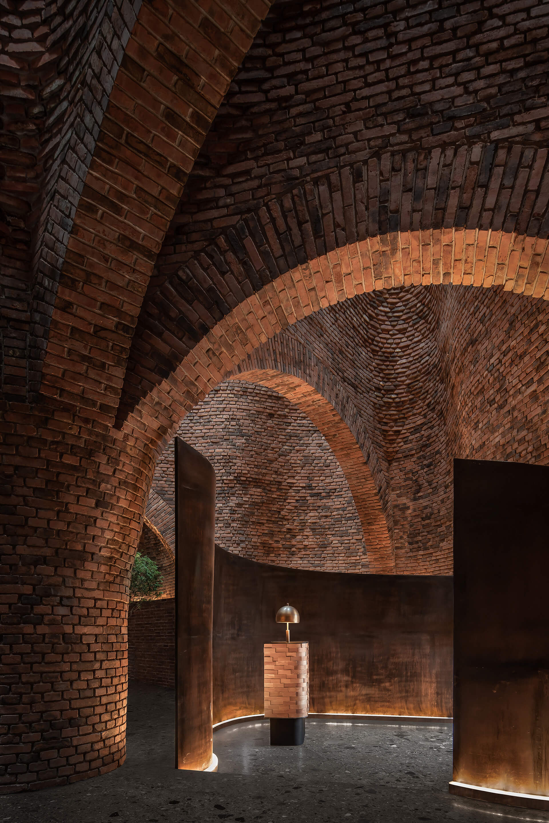 The exposed brick exterior is echoed within | 50% Cloud Artists Lounge by Cheng Chung Design | STIRworld