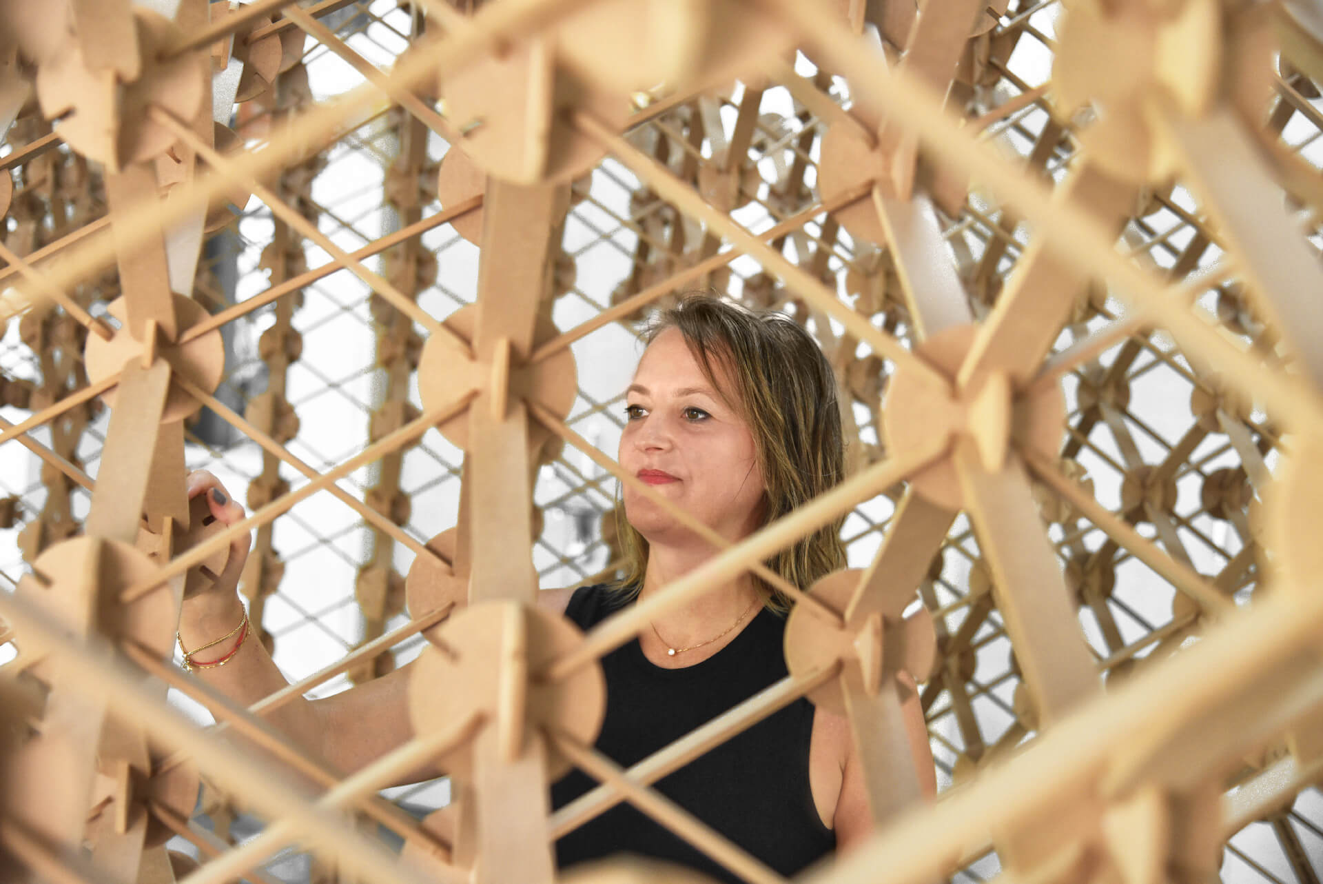 Britta inside one of the perforated prototypes | Plexus by Studio Symbiosis | STIRworld