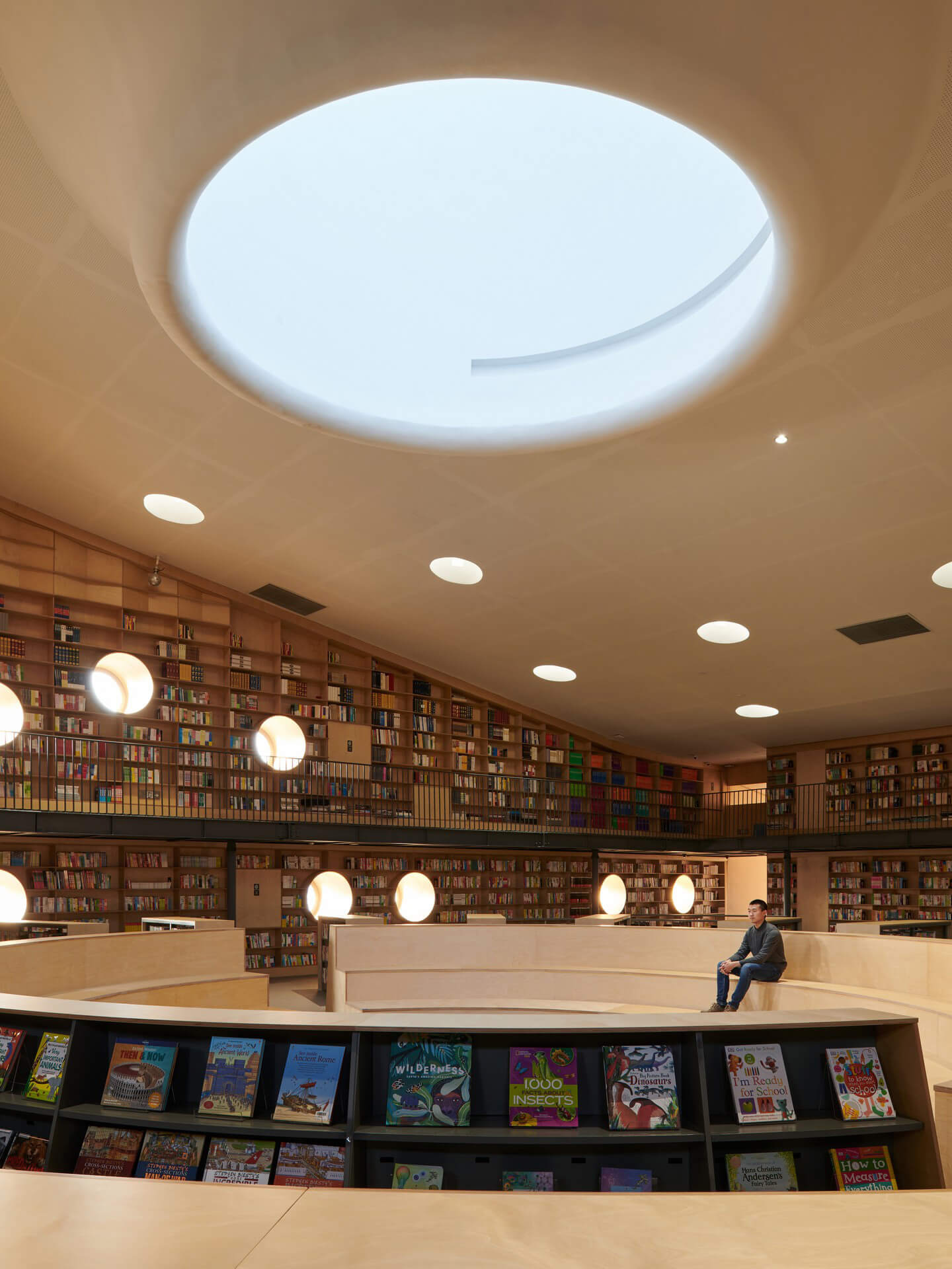 The library's stepped central reading space is the building's sacred heart | Pinghe Bibliotheatre| OPEN Architecture | STIRworld