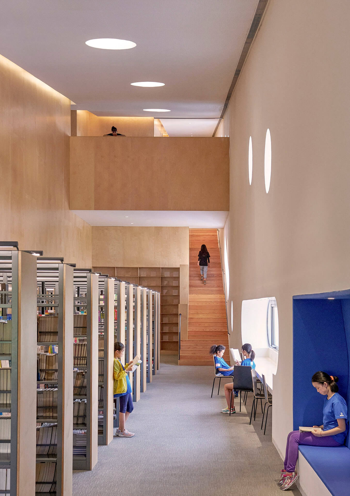 Reading room with open stacks along the periphery of the building | Pinghe Bibliotheatre| OPEN Architecture | STIRworld