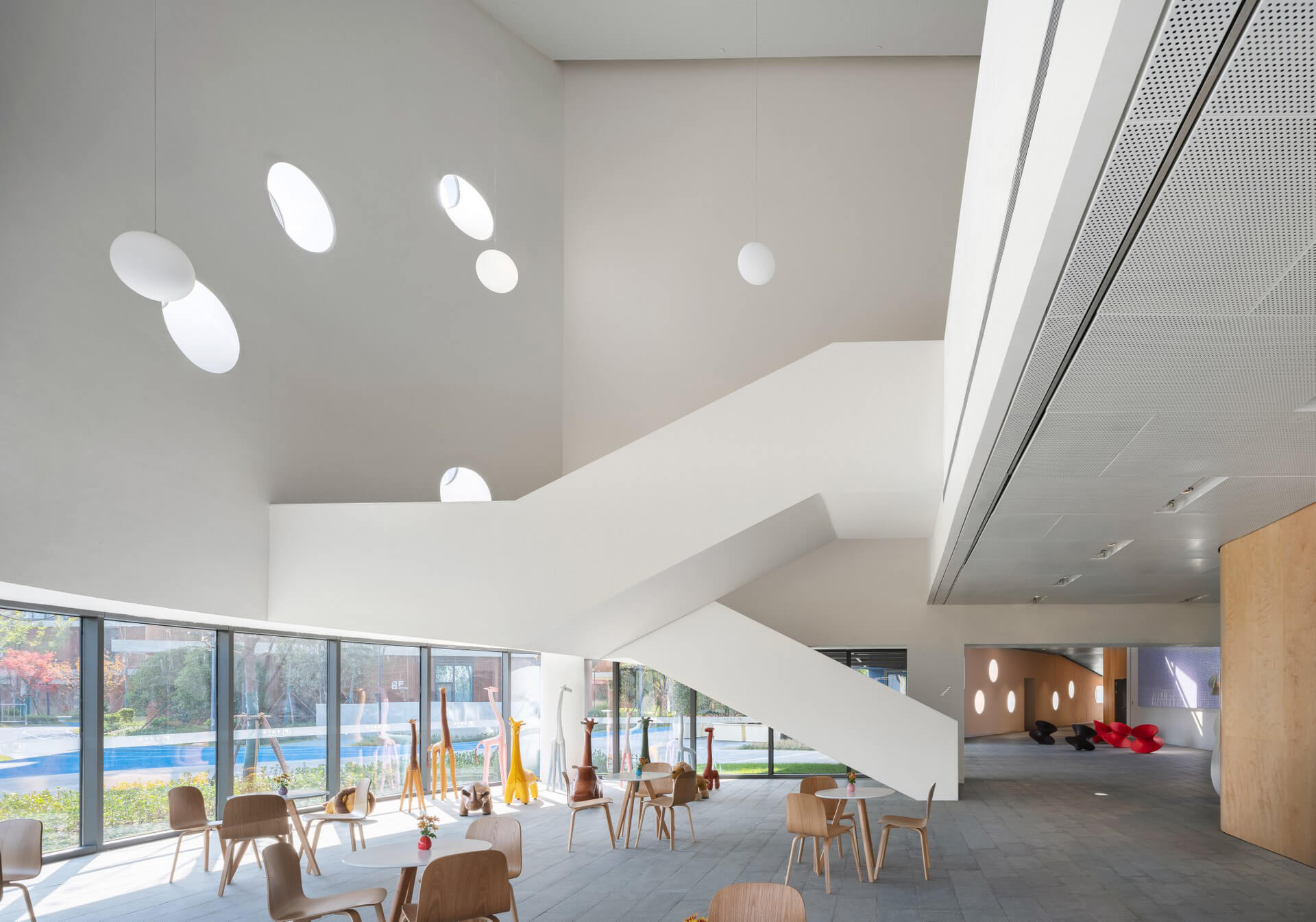 The school's café is amply naturally lit | Pinghe Bibliotheatre| OPEN Architecture | STIRworld