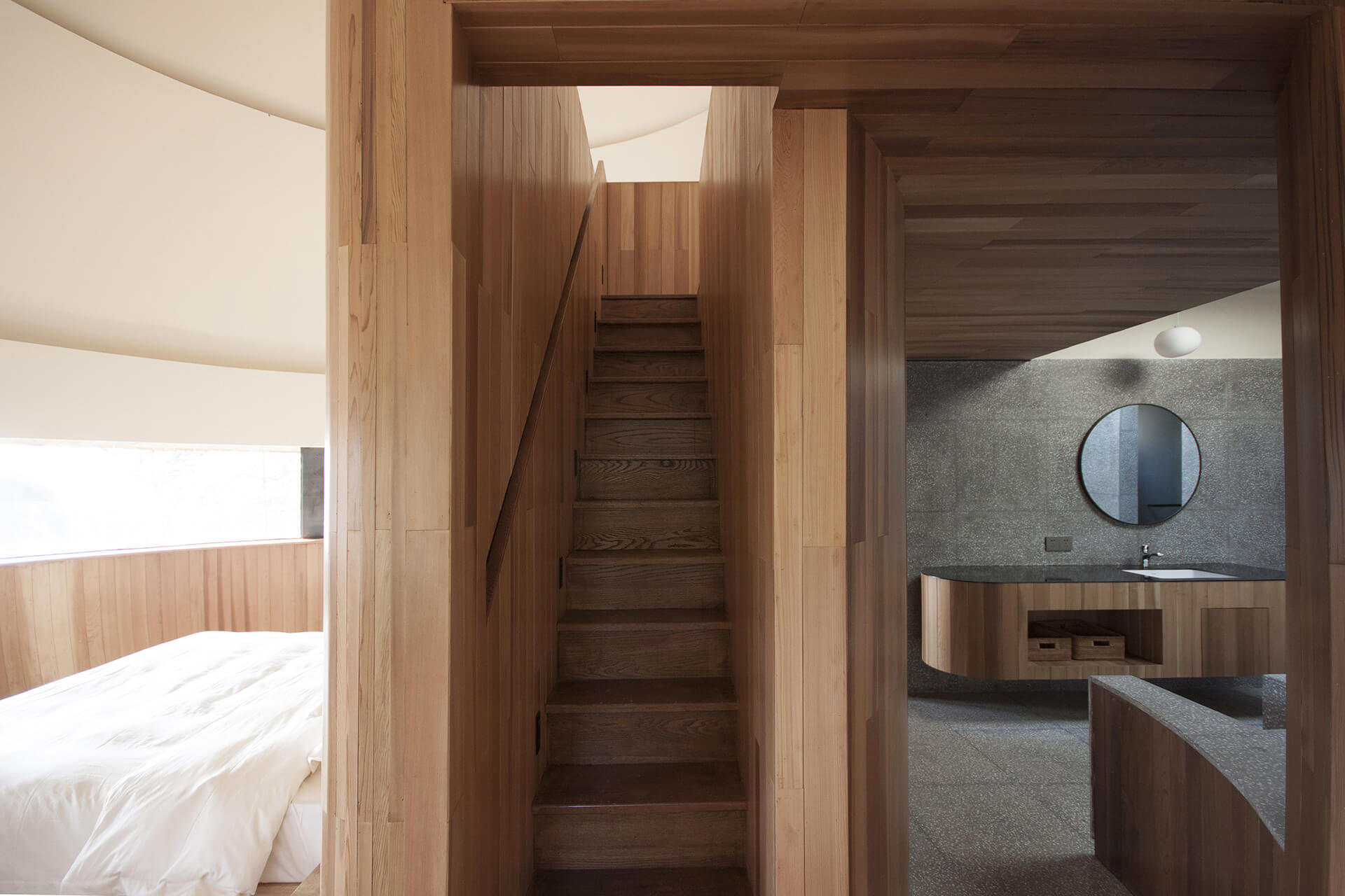A compact wood finished staircase with a wall-recessed handrail leads to the Mushroom's upper loft |ZJJZ | China | STIRworld