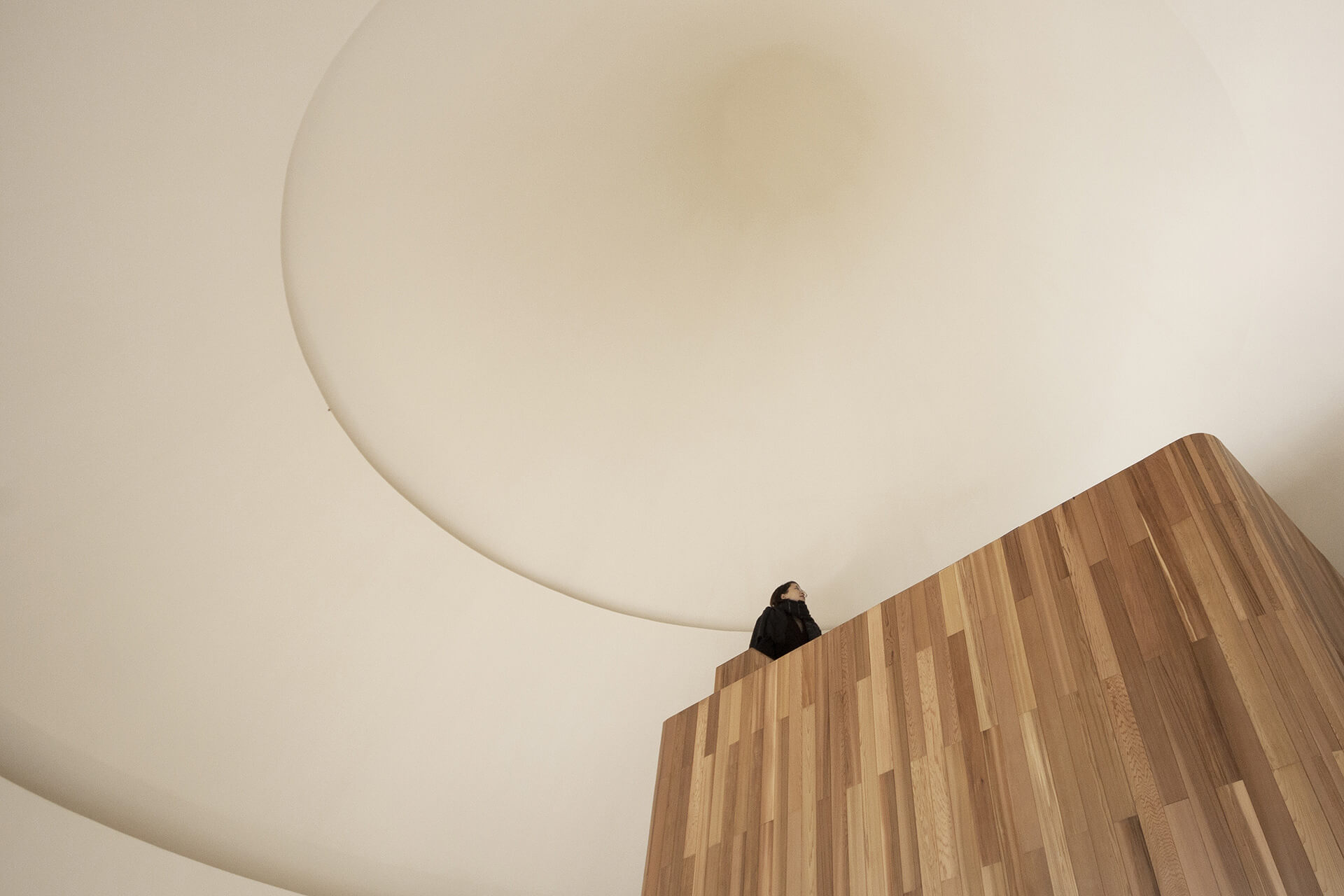 The pure white interior of the home's soaring conical ceiling is rounded at the top |ZJJZ | China | STIRworld