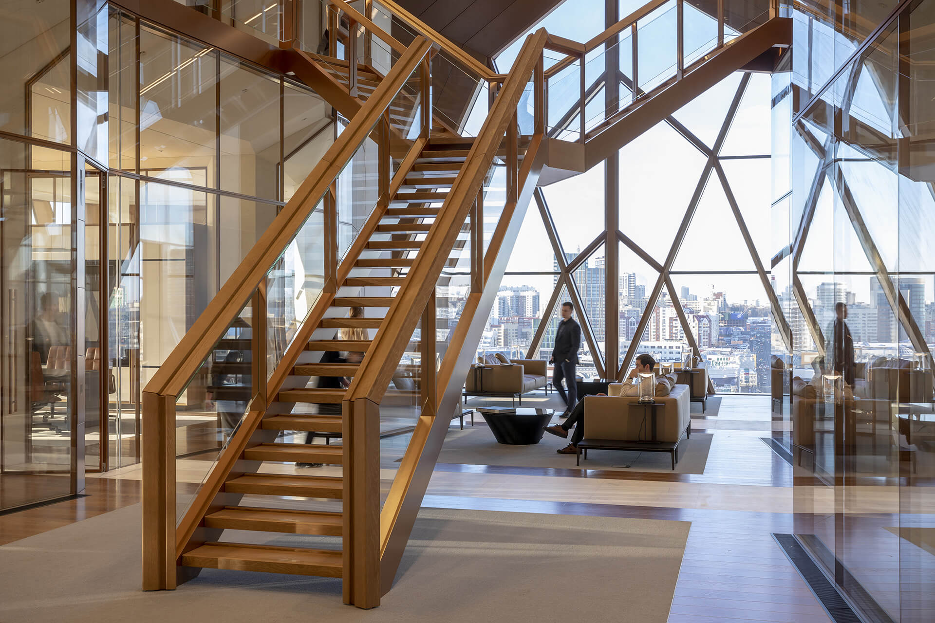 The space features a bifurcated staircase | RCC Headquarters by Foster + Partners | STIRworld