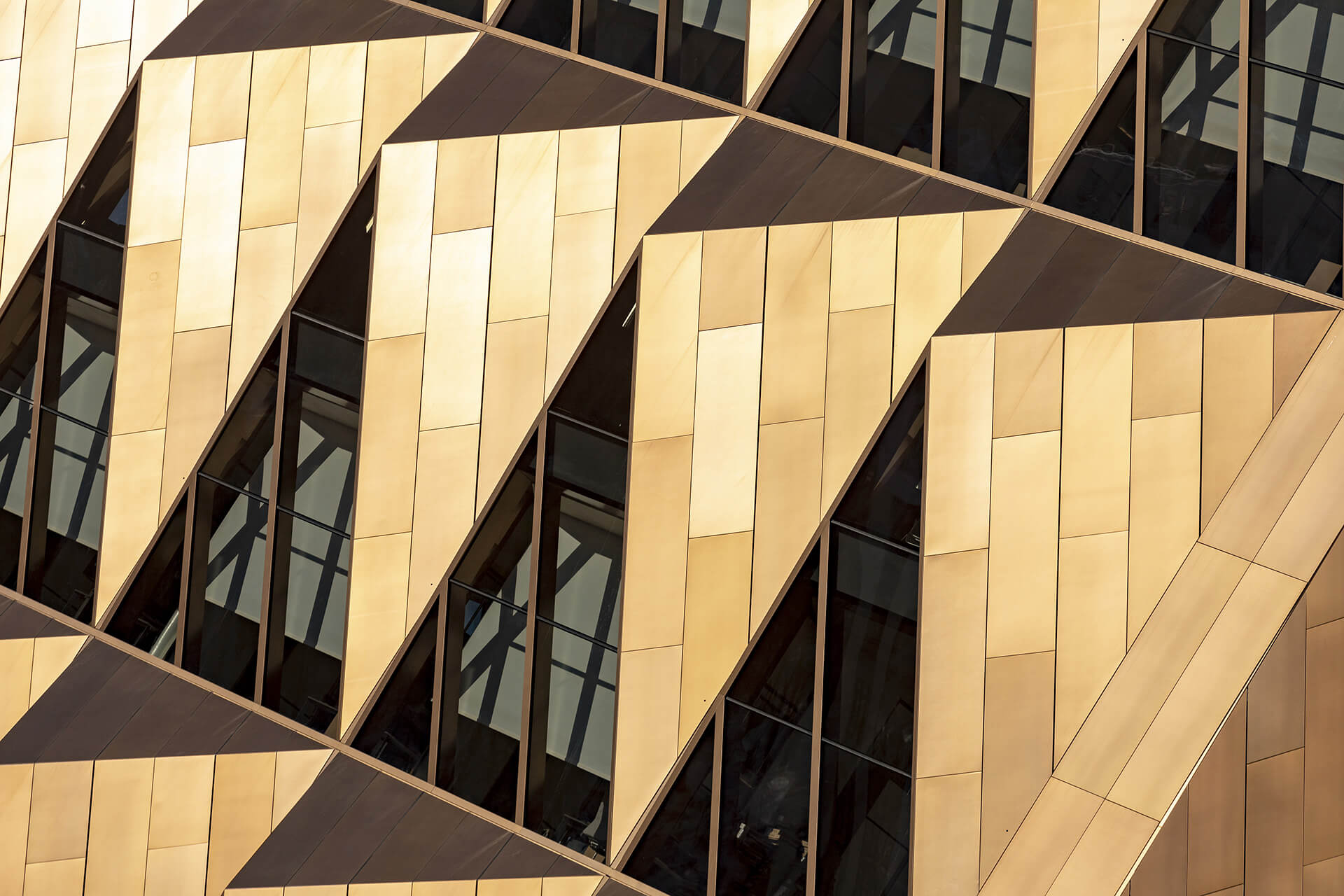 The building's unitised facade scheme combines triple-glazed sections with triangular elements inspired by the crystalline lattice structure of copper | RCC Headquarters by Foster + Partners | STIRworld