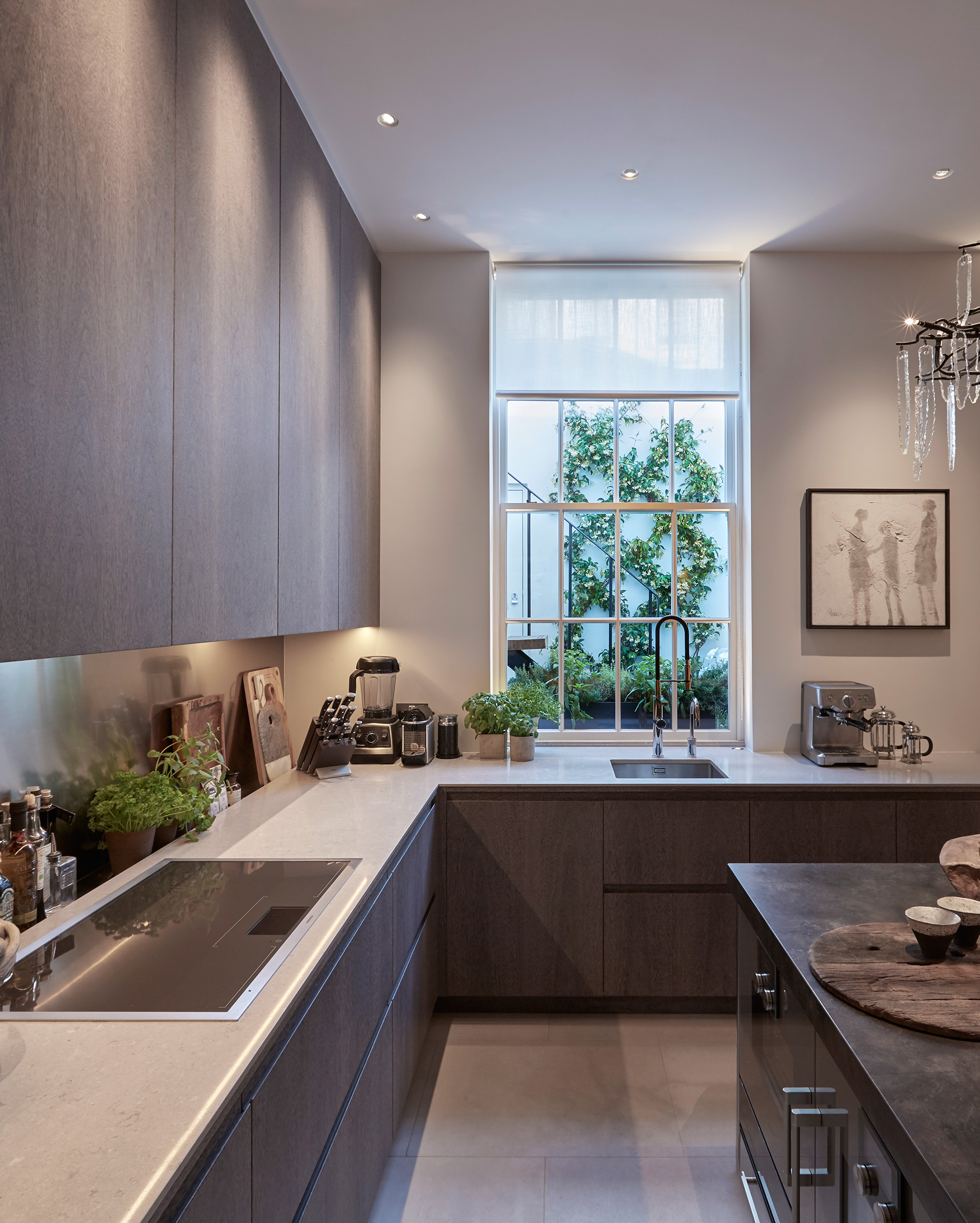 The kitchen also overlooks a small outdoor area flush with greenery| Louise Bradley| London| STIR