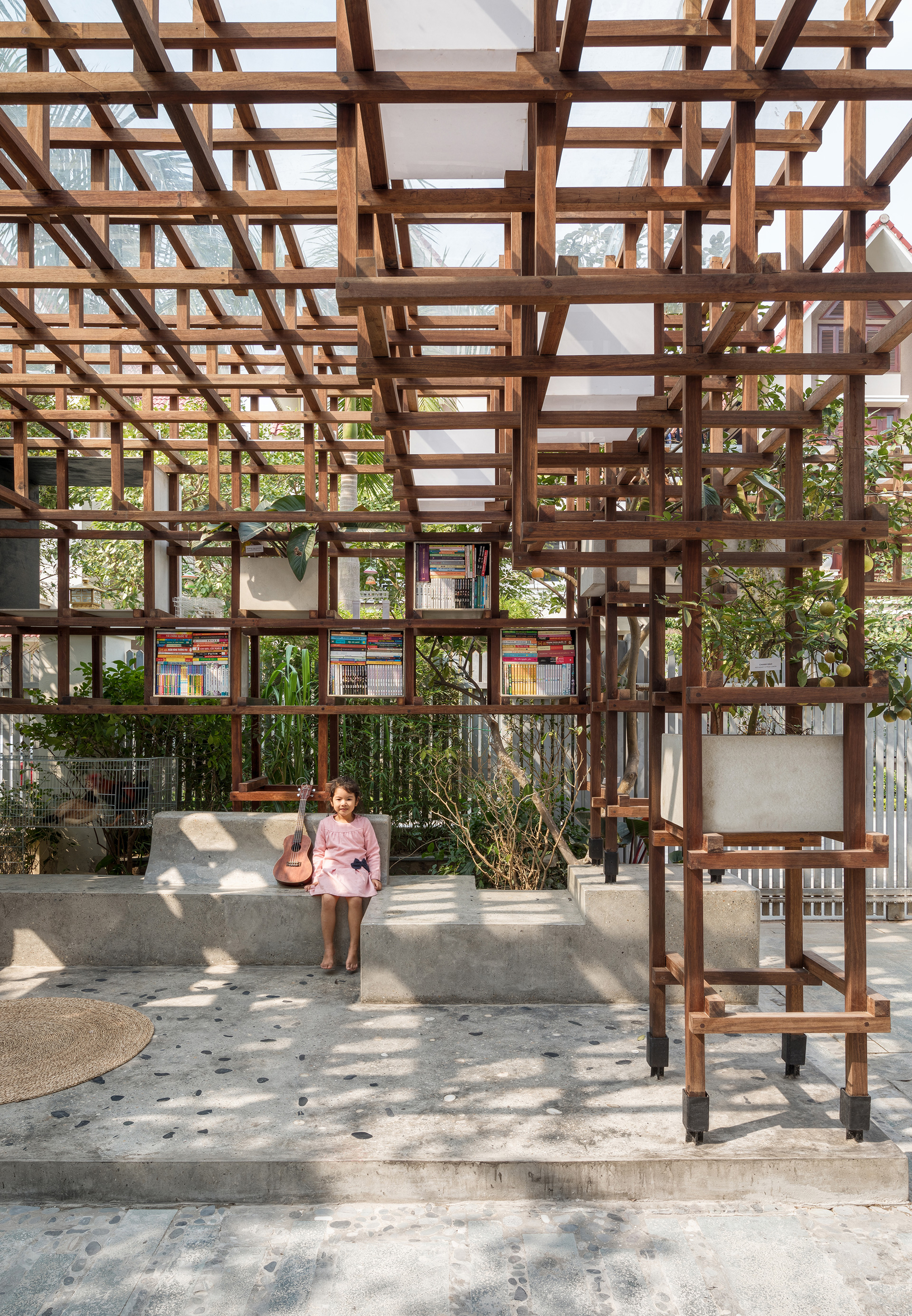 A quaint little stone plaza sits at the heart of the wooden grid | VAC Library | Farming Architects | STIR