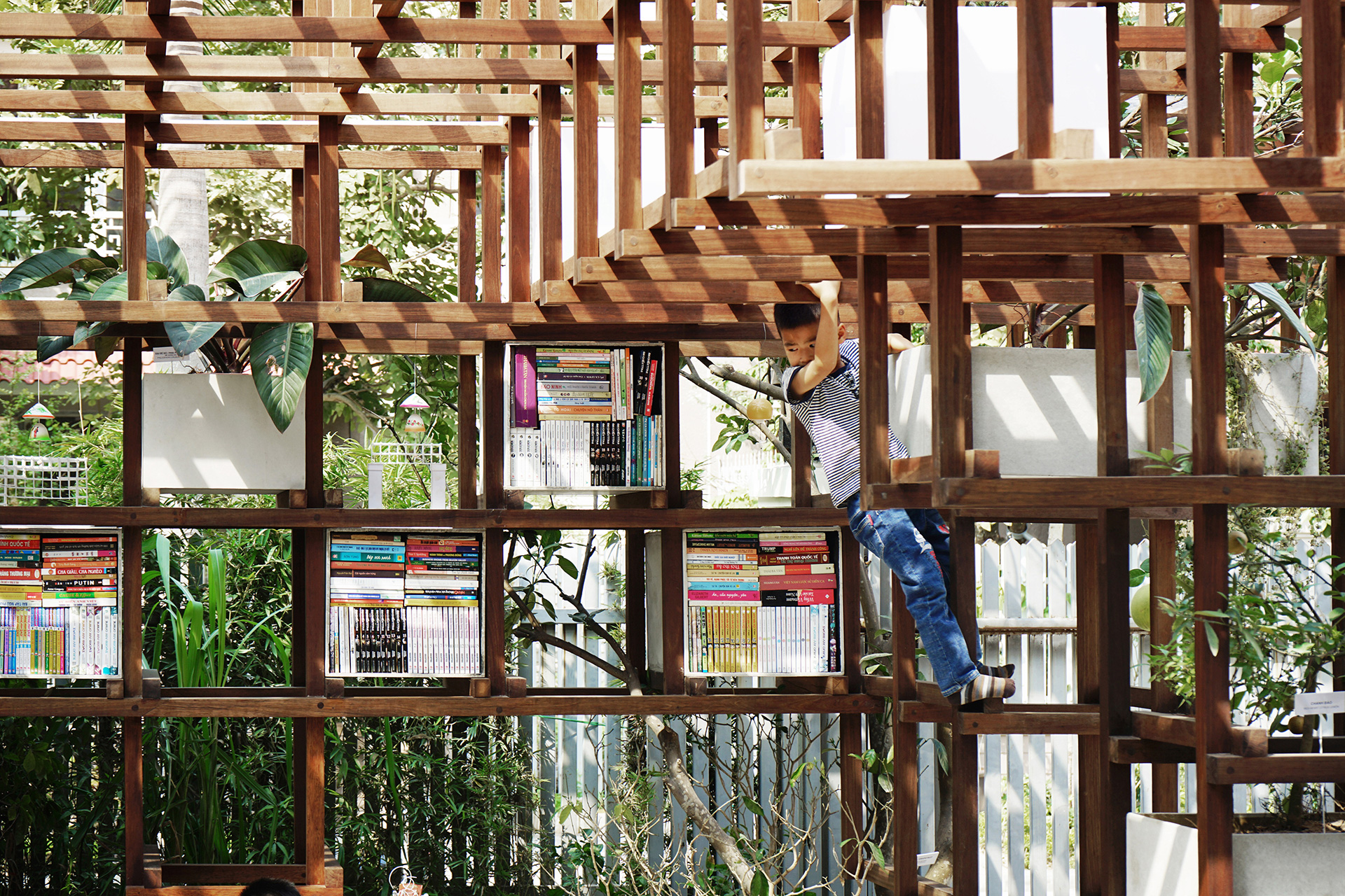 : More than anything, children love climbing the wooden beams | VAC Library | Farming Architects | STIR